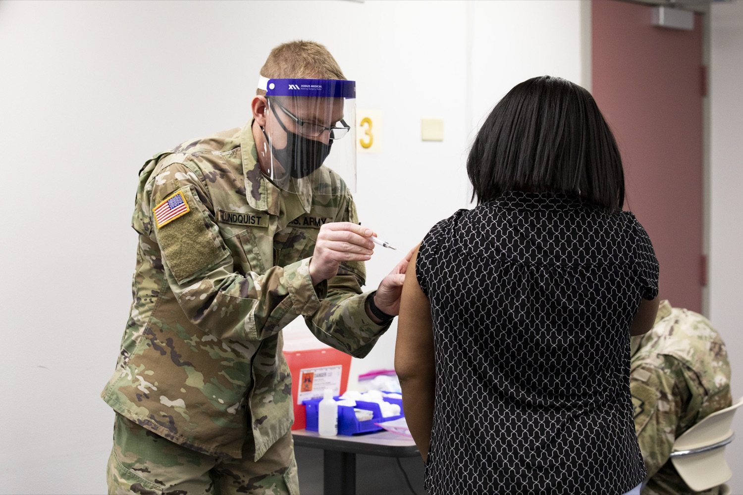 """<a href=""""https://filesource.wostreaming.net/commonwealthofpa/photo/18591_gov_vaccineIU_cz_10.jpg"""" target=""""_blank"""">⇣Download Photo<br></a>Members of the Pennsylvania National Guard vaccinate educators at the Capital Area Intermediate Unit in Summerdale, PA on March 11, 2021."""