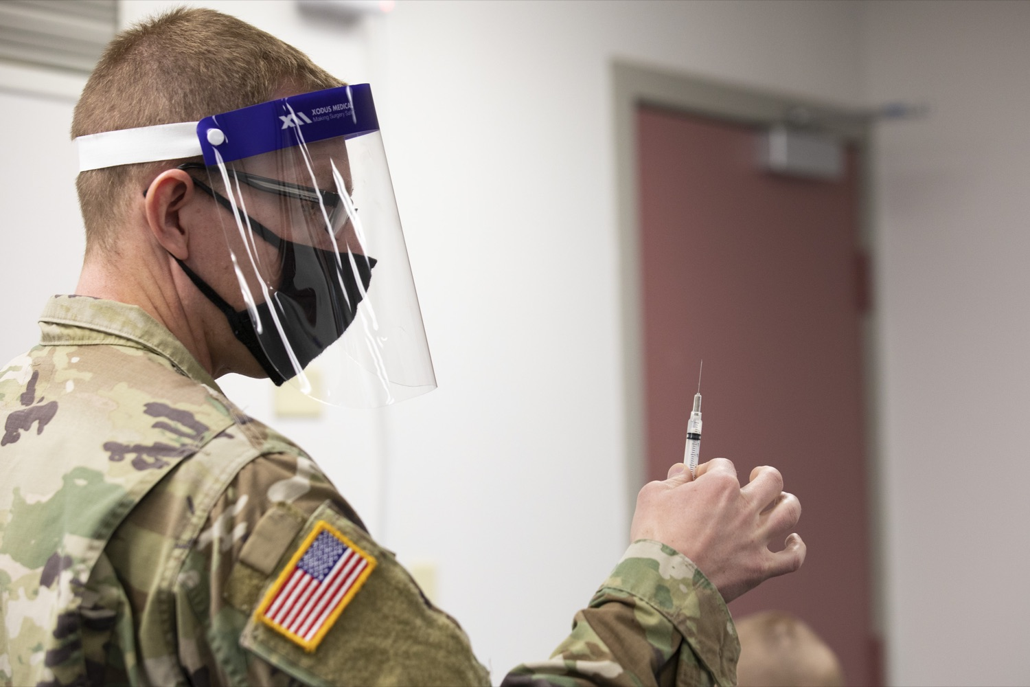 """<a href=""""https://filesource.wostreaming.net/commonwealthofpa/photo/18591_gov_vaccineIU_cz_11.jpg"""" target=""""_blank"""">⇣Download Photo<br></a>Members of the Pennsylvania National Guard vaccinate educators at the Capital Area Intermediate Unit in Summerdale, PA on March 11, 2021."""