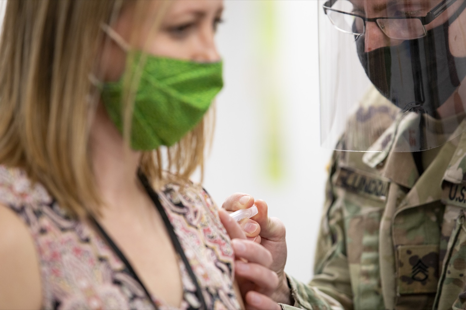 """<a href=""""https://filesource.wostreaming.net/commonwealthofpa/photo/18591_gov_vaccineIU_cz_14.jpg"""" target=""""_blank"""">⇣Download Photo<br></a>Members of the Pennsylvania National Guard vaccinate educators at the Capital Area Intermediate Unit in Summerdale, PA on March 11, 2021."""