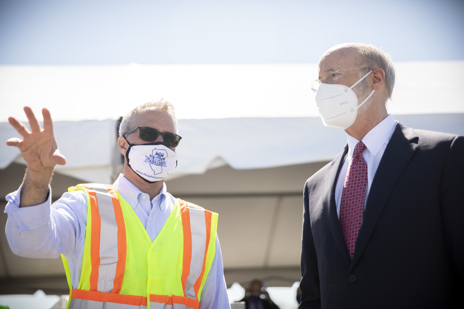 """<a href=""""https://filesource.wostreaming.net/commonwealthofpa/photo/18631_gov_hacc_vaccine_dz_005.jpg"""" target=""""_blank"""">⇣Download Photo<br></a>Pennsylvania Governor Tom Wolf touring the vaccination site.  Governor Wolf today visited the COVID-19 drive-thru mass vaccination clinic for Dauphin County residents at Harrisburg Area Community College. The drive-thru clinic was developed in partnership with UPMC Pinnacle and Dauphin County. He was joined by UPMC Pinnacle President Phil Guarneschelli and Dauphin County Commissioners Mike Pries and George P. Hartwick III.  HARRISBURG, PA -- March 30, 2021"""
