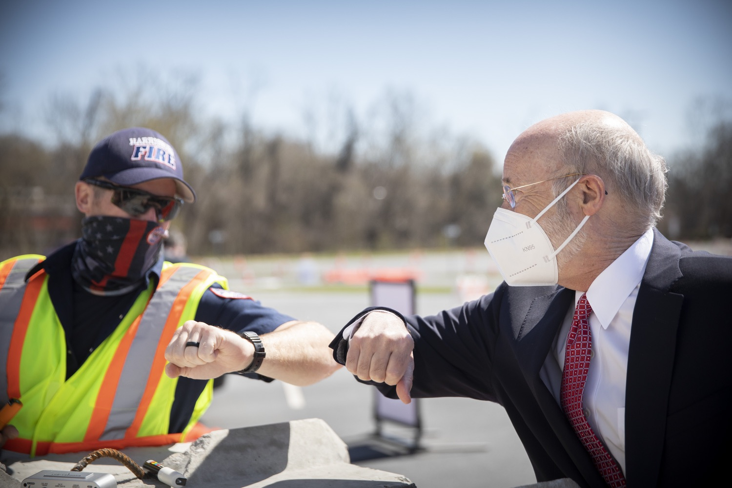 """<a href=""""https://filesource.wostreaming.net/commonwealthofpa/photo/18631_gov_hacc_vaccine_dz_006.jpg"""" target=""""_blank"""">⇣Download Photo<br></a>Pennsylvania Governor Tom Wolf greeting workers at the vaccination site.Governor Wolf today visited the COVID-19 drive-thru mass vaccination clinic for Dauphin County residents at Harrisburg Area Community College. The drive-thru clinic was developed in partnership with UPMC Pinnacle and Dauphin County. He was joined by UPMC Pinnacle President Phil Guarneschelli and Dauphin County Commissioners Mike Pries and George P. Hartwick III.  HARRISBURG, PA -- March 30, 2021"""