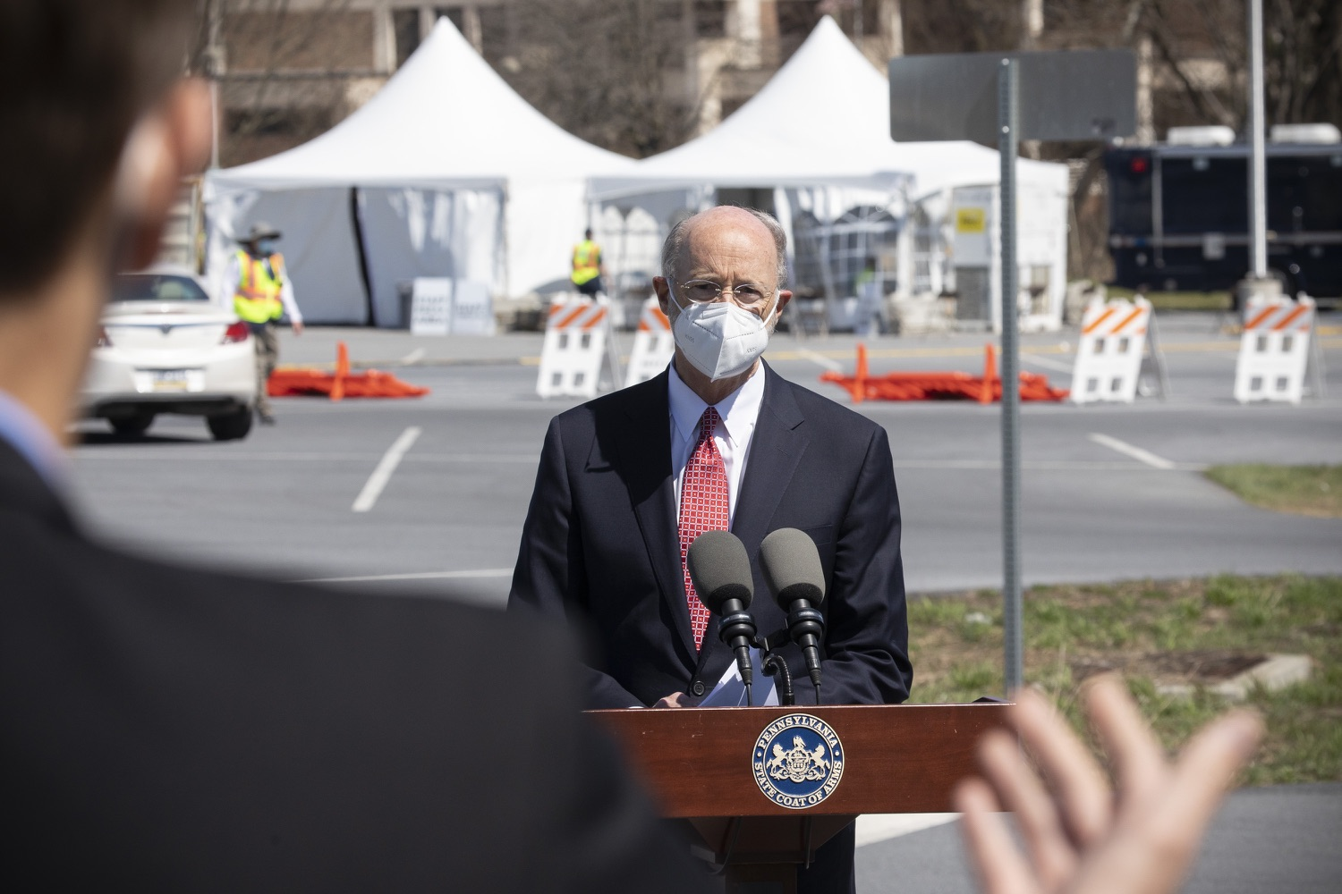 """<a href=""""https://filesource.wostreaming.net/commonwealthofpa/photo/18631_gov_hacc_vaccine_dz_010.jpg"""" target=""""_blank"""">⇣Download Photo<br></a>Pennsylvania Governor Tom Wolf speaking with the press.  Governor Wolf today visited the COVID-19 drive-thru mass vaccination clinic for Dauphin County residents at Harrisburg Area Community College. The drive-thru clinic was developed in partnership with UPMC Pinnacle and Dauphin County. He was joined by UPMC Pinnacle President Phil Guarneschelli and Dauphin County Commissioners Mike Pries and George P. Hartwick III.  HARRISBURG, PA -- March 30, 2021"""