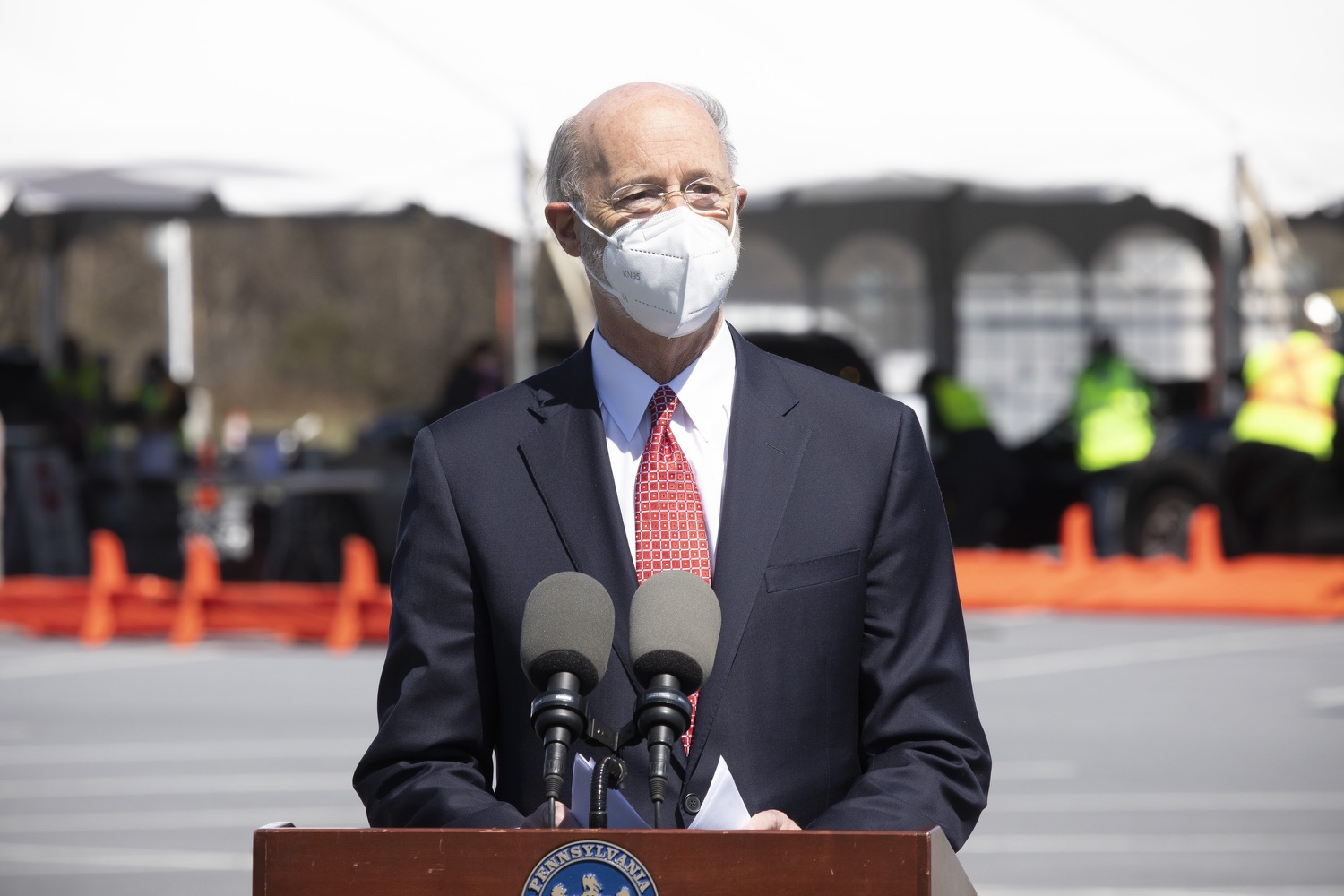 """<a href=""""https://filesource.wostreaming.net/commonwealthofpa/photo/18631_gov_hacc_vaccine_dz_011.jpg"""" target=""""_blank"""">⇣Download Photo<br></a>Pennsylvania Governor Tom Wolf speaking with the press.  Governor Wolf today visited the COVID-19 drive-thru mass vaccination clinic for Dauphin County residents at Harrisburg Area Community College. The drive-thru clinic was developed in partnership with UPMC Pinnacle and Dauphin County. He was joined by UPMC Pinnacle President Phil Guarneschelli and Dauphin County Commissioners Mike Pries and George P. Hartwick III.  HARRISBURG, PA -- March 30, 2021"""