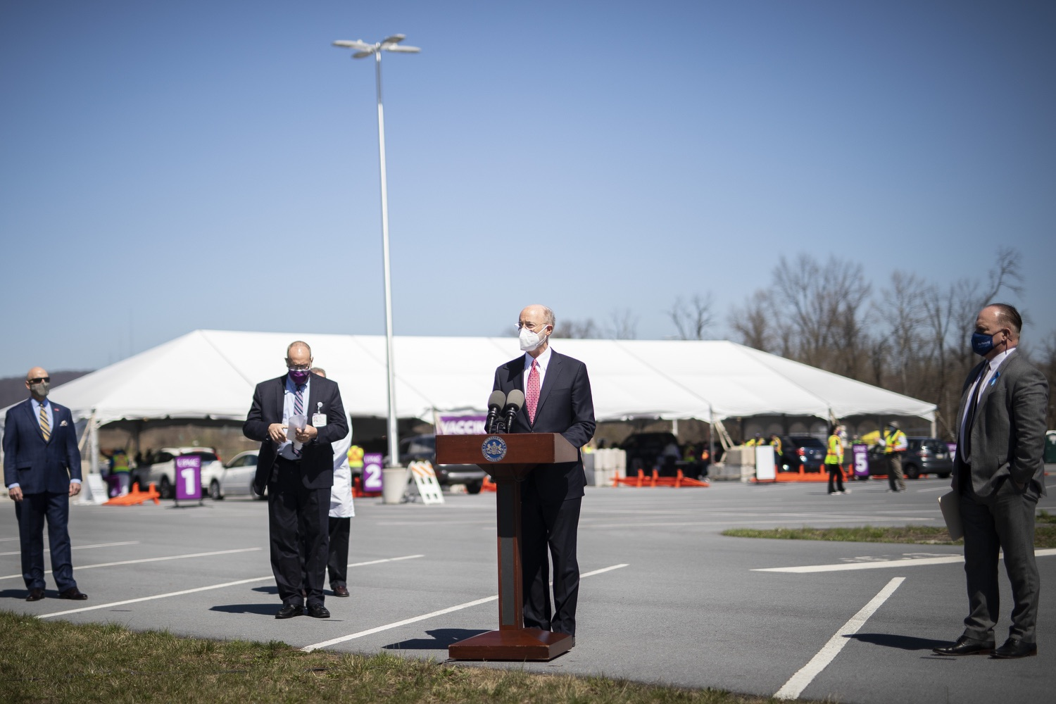 """<a href=""""https://filesource.wostreaming.net/commonwealthofpa/photo/18631_gov_hacc_vaccine_dz_012.jpg"""" target=""""_blank"""">⇣Download Photo<br></a>Pennsylvania Governor Tom Wolf speaking with the press.  Governor Wolf today visited the COVID-19 drive-thru mass vaccination clinic for Dauphin County residents at Harrisburg Area Community College. The drive-thru clinic was developed in partnership with UPMC Pinnacle and Dauphin County. He was joined by UPMC Pinnacle President Phil Guarneschelli and Dauphin County Commissioners Mike Pries and George P. Hartwick III.  HARRISBURG, PA -- March 30, 2021"""