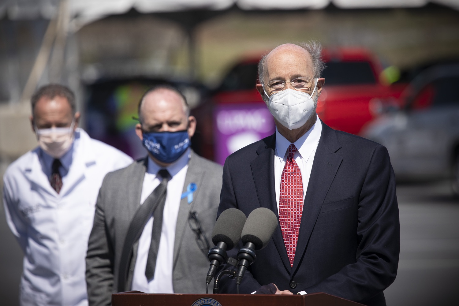 """<a href=""""https://filesource.wostreaming.net/commonwealthofpa/photo/18631_gov_hacc_vaccine_dz_017.jpg"""" target=""""_blank"""">⇣Download Photo<br></a>Pennsylvania Governor Tom Wolf speaking with the press.  Governor Wolf today visited the COVID-19 drive-thru mass vaccination clinic for Dauphin County residents at Harrisburg Area Community College. The drive-thru clinic was developed in partnership with UPMC Pinnacle and Dauphin County. He was joined by UPMC Pinnacle President Phil Guarneschelli and Dauphin County Commissioners Mike Pries and George P. Hartwick III.  HARRISBURG, PA -- March 30, 2021"""