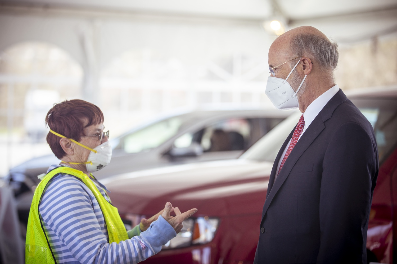 """<a href=""""https://filesource.wostreaming.net/commonwealthofpa/photo/18631_gov_hacc_vaccine_dz_020.jpg"""" target=""""_blank"""">⇣Download Photo<br></a>Pennsylvania Governor Tom Wolf greeting workers at the vaccination site.Governor Wolf today visited the COVID-19 drive-thru mass vaccination clinic for Dauphin County residents at Harrisburg Area Community College. The drive-thru clinic was developed in partnership with UPMC Pinnacle and Dauphin County. He was joined by UPMC Pinnacle President Phil Guarneschelli and Dauphin County Commissioners Mike Pries and George P. Hartwick III.  HARRISBURG, PA -- March 30, 2021"""