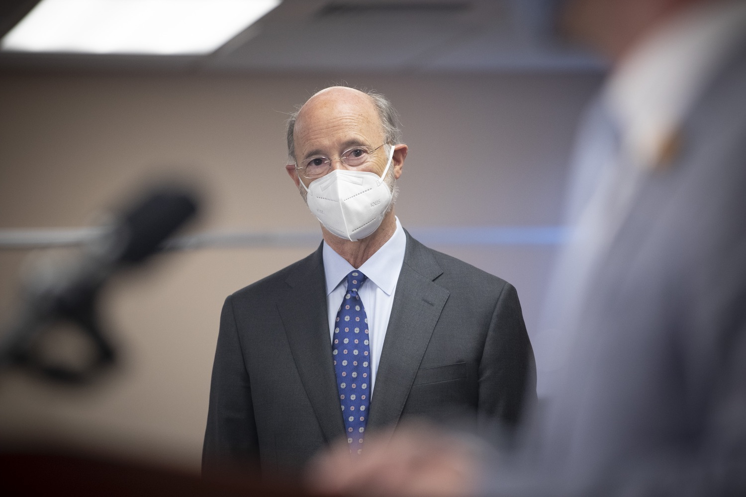 """<a href=""""https://filesource.wostreaming.net/commonwealthofpa/photo/18646_gov_vaccines_dz_012.jpg"""" target=""""_blank"""">⇣Download Photo<br></a>Pennsylvania Governor Tom Wolf listening to speakers.  After vaccinating more than 112,500 teachers and school staff in only about three weeks, Governor Tom Wolf visited Luzerne County today to announce the special vaccination initiative is a success and was completed ahead of schedule. The accomplishment is an important step to help more students and teachers safely return to classrooms across the state.  Kingston, PA - April 2, 2021"""