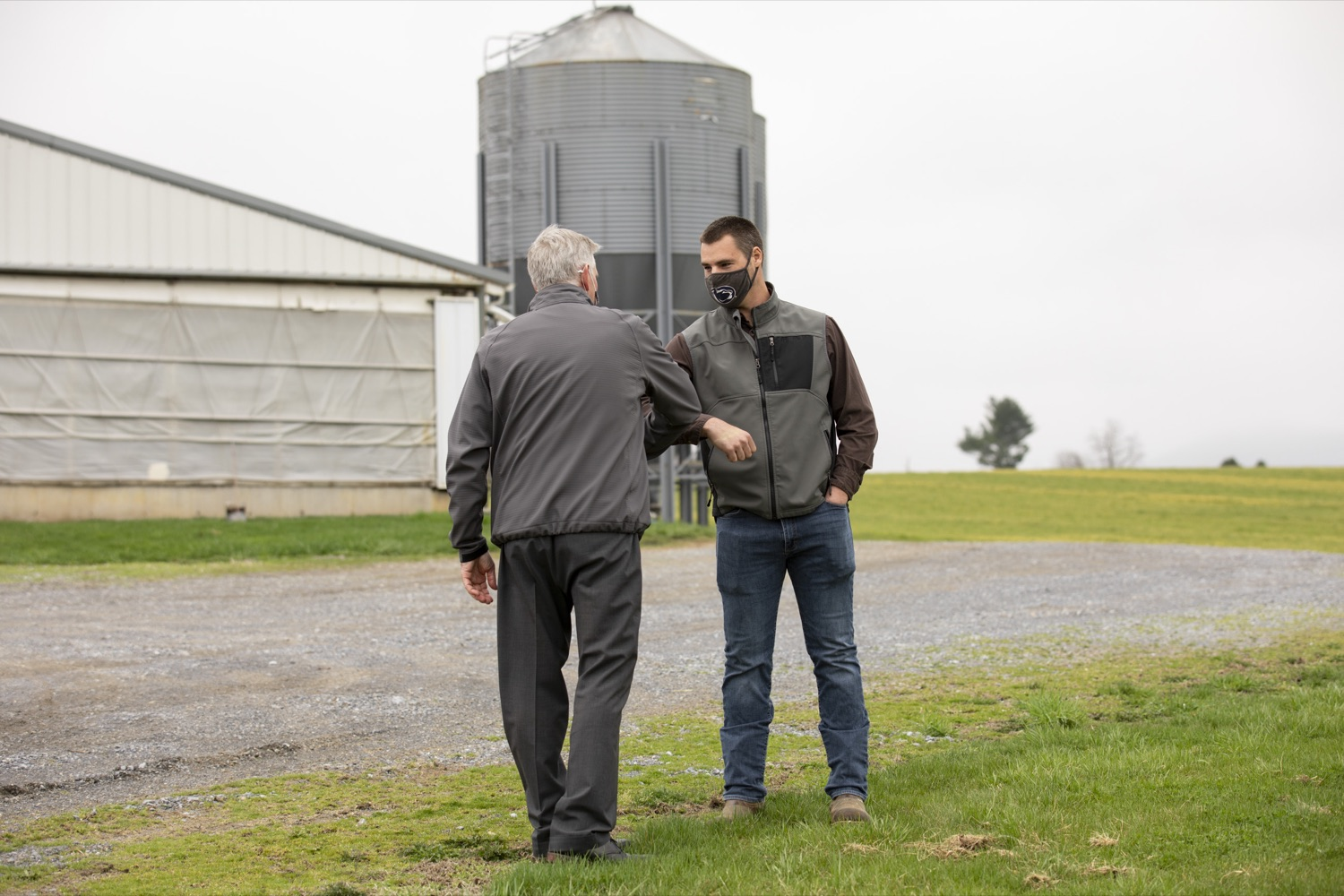 """<a href=""""https://filesource.wostreaming.net/commonwealthofpa/photo/18647_agric_vitalityGrants_cz_11.jpg"""" target=""""_blank"""">⇣Download Photo<br></a>Secretary of Agriculture Russell Redding greets Trevor Gill, a farm owner and grant recipient, in Boiling Springs, PA on April 9, 2021."""