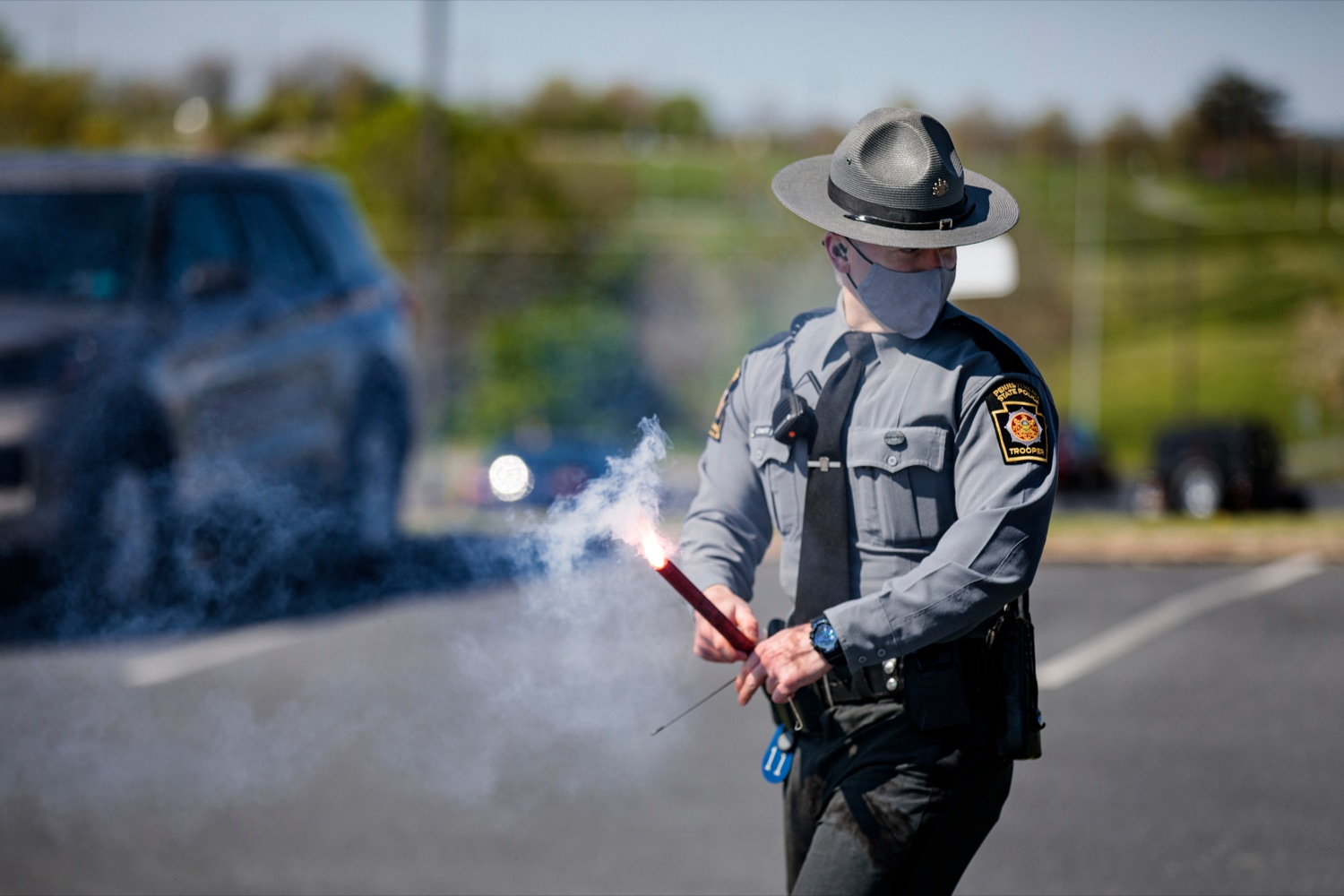 "<a href=""https://filesource.wostreaming.net/commonwealthofpa/photo/18650_PennDOT_WorkZone_NK_002.jpg"" target=""_blank"">⇣ Download Photo<br></a>Pennsylvania State Police Trooper Corre Sommers lights a flare during a press conference promoting National Work Zone Awareness Week outside of Pennsylvania State Police Headquarters on Monday, April 26, 2021."