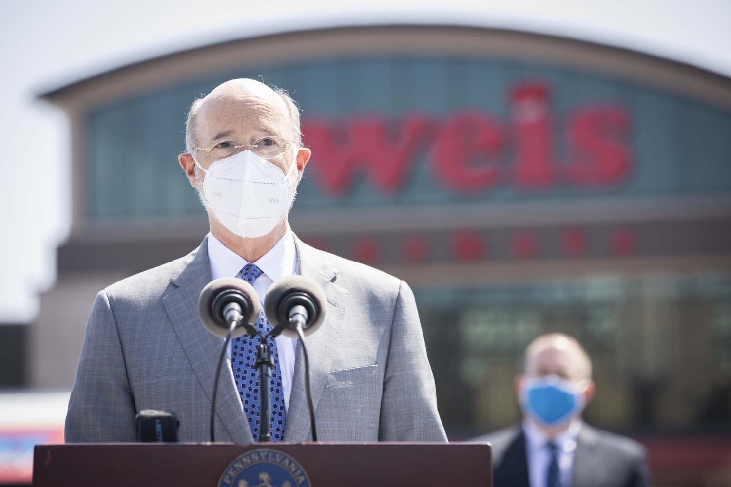 """<a href=""""https://filesource.wostreaming.net/commonwealthofpa/photo/18654_gov_vaccineeligibility_dz_001.jpg"""" target=""""_blank"""">⇣Download Photo<br></a>Pennsylvania Governor Tom Wolf speaking to the press.  Gov. Tom Wolf visited Weis Markets in Enola, Cumberland County, to recognize the heroic efforts of Pennsylvania's grocery store workers, who are now eligible for the COVID-19 vaccine.  The governor expressed his gratitude to Pennsylvania's 180,000 grocery store workers, who suddenly became frontline workers as the state took critical steps to mitigate the spread of COVID-19. Grocery stores were deemed life-sustaining businesses, and these employees put their lives at risk to ensure their stores remained open to the public. APRIL 06, 2021 - ENOLA, PA.."""