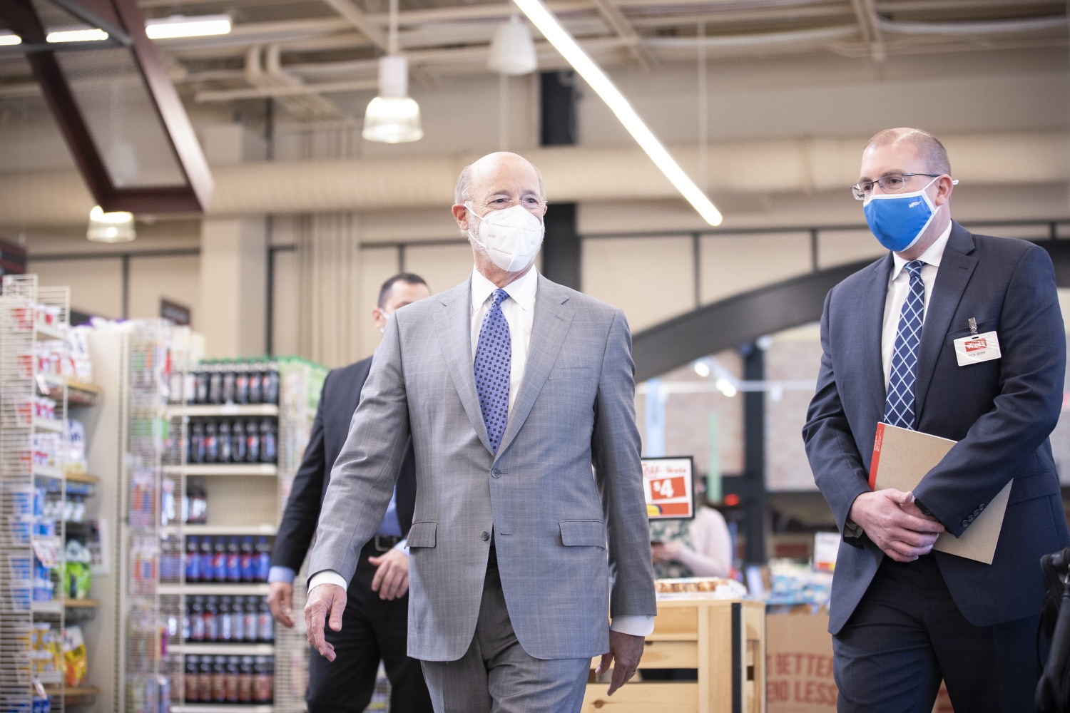 """<a href=""""https://filesource.wostreaming.net/commonwealthofpa/photo/18654_gov_vaccineeligibility_dz_014.jpg"""" target=""""_blank"""">⇣Download Photo<br></a>Pennsylvania Governor Tom Wolf tours of Weis Markets with Rick Seipp, vice president of Weis Pharmacy to see the vaccine administration area.   Gov. Tom Wolf visited Weis Markets in Enola, Cumberland County, to recognize the heroic efforts of Pennsylvania's grocery store workers, who are now eligible for the COVID-19 vaccine.  The governor expressed his gratitude to Pennsylvania's 180,000 grocery store workers, who suddenly became frontline workers as the state took critical steps to mitigate the spread of COVID-19. Grocery stores were deemed life-sustaining businesses, and these employees put their lives at risk to ensure their stores remained open to the public. APRIL 06, 2021 - ENOLA, PA.."""