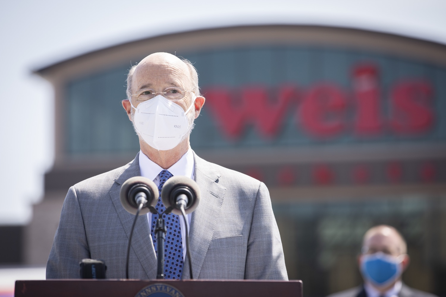 """<a href=""""https://filesource.wostreaming.net/commonwealthofpa/photo/18654_gov_vaccineeligibility_dz_016.jpg"""" target=""""_blank"""">⇣Download Photo<br></a>Pennsylvania Governor Tom Wolf speaking to the press.  Gov. Tom Wolf visited Weis Markets in Enola, Cumberland County, to recognize the heroic efforts of Pennsylvania's grocery store workers, who are now eligible for the COVID-19 vaccine.  The governor expressed his gratitude to Pennsylvania's 180,000 grocery store workers, who suddenly became frontline workers as the state took critical steps to mitigate the spread of COVID-19. Grocery stores were deemed life-sustaining businesses, and these employees put their lives at risk to ensure their stores remained open to the public. APRIL 06, 2021 - ENOLA, PA.."""
