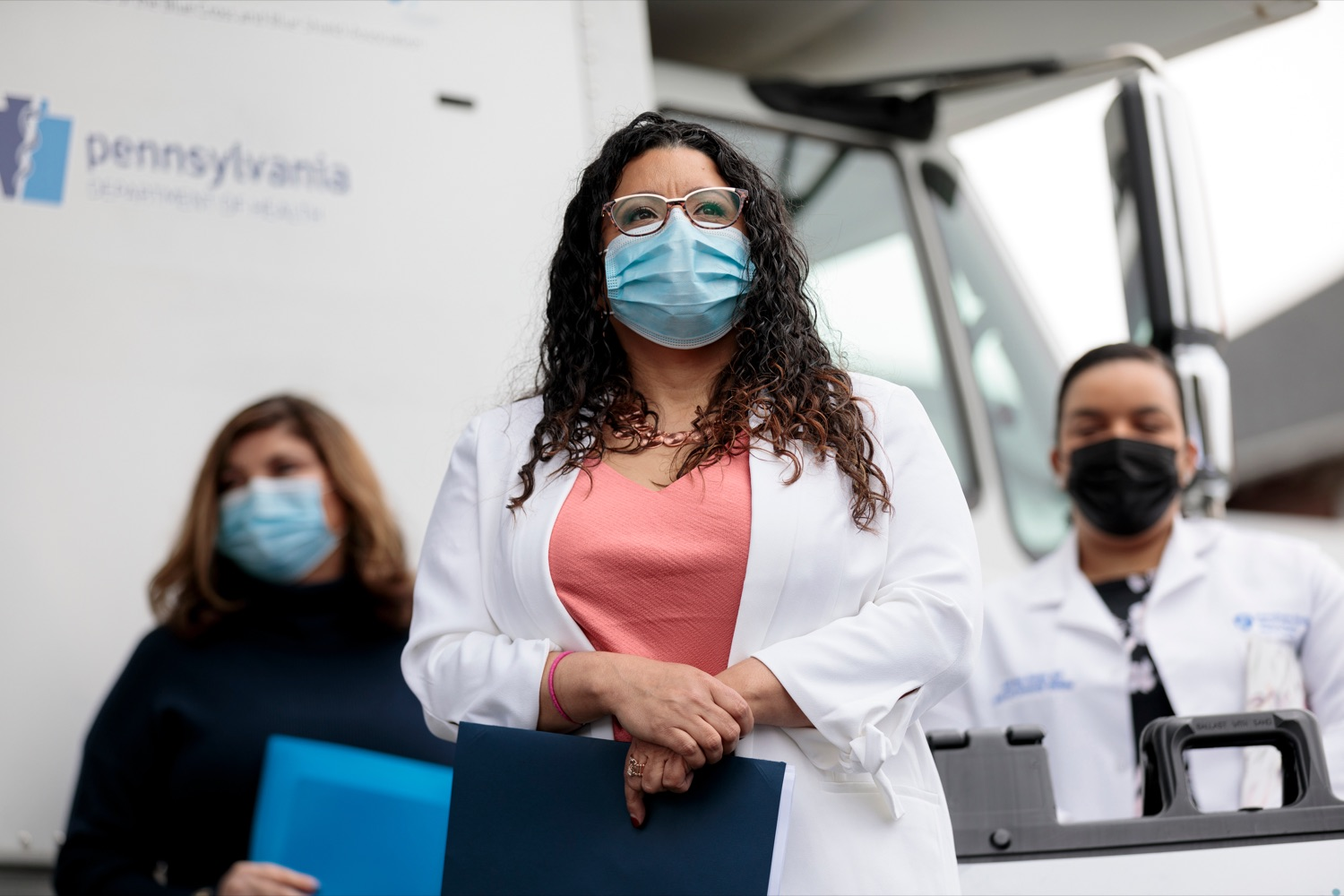 """<a href=""""https://filesource.wostreaming.net/commonwealthofpa/photo/18675_DOH_Beacon_Clinic_NK_003.jpg"""" target=""""_blank"""">⇣Download Photo<br></a>Governor Wolfs Advisory Commission on Latino Affairs Executive Director Luz Colon stands during a press conference, which discussed an upcoming COVID-19 mobile response vaccination tour to provide vaccinations and education to minority and underserved communities across the commonwealth, outside of Beacon Clinic in Harrisburg on Monday, April 12, 2021."""