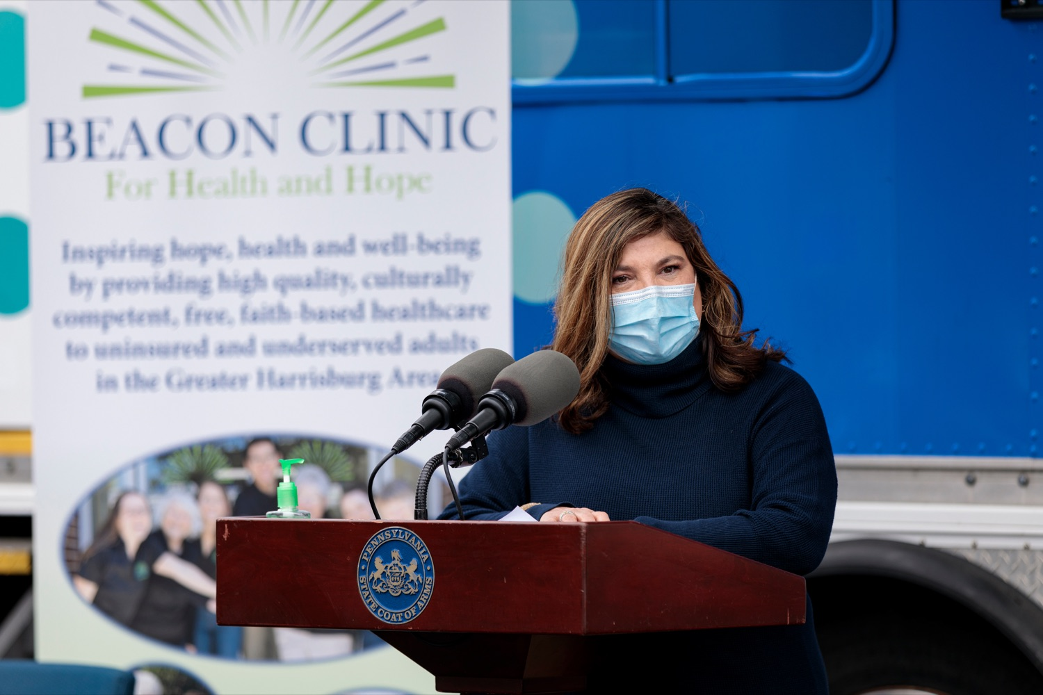 """<a href=""""https://filesource.wostreaming.net/commonwealthofpa/photo/18675_DOH_Beacon_Clinic_NK_009.jpg"""" target=""""_blank"""">⇣Download Photo<br></a>Highmark Blue Shield Medical Policy Research Analyst Dr. Oralia Dominic speaks during a press conference, which discussed an upcoming COVID-19 mobile response vaccination tour to provide vaccinations and education to minority and underserved communities across the commonwealth, outside of Beacon Clinic in Harrisburg on Monday, April 12, 2021."""