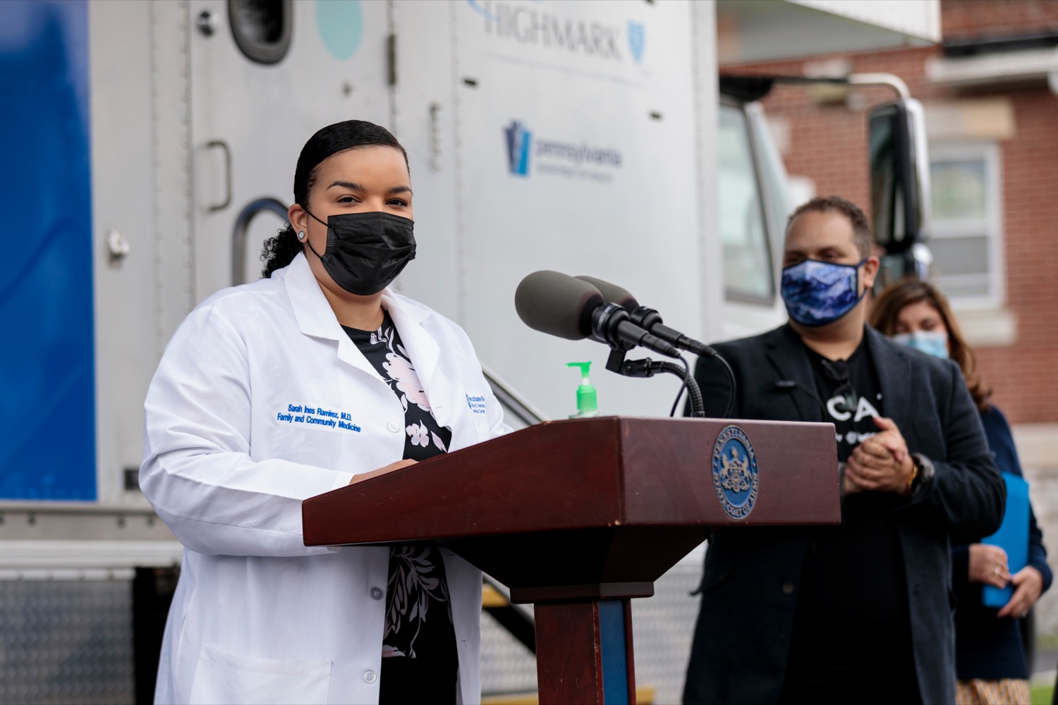 """<a href=""""https://filesource.wostreaming.net/commonwealthofpa/photo/18675_DOH_Beacon_Clinic_NK_010.jpg"""" target=""""_blank"""">⇣Download Photo<br></a>Penn State Health System clinician Dr. Sarah Ramirez speaks during a press conference, which discussed an upcoming COVID-19 mobile response vaccination tour to provide vaccinations and education to minority and underserved communities across the commonwealth, outside of Beacon Clinic in Harrisburg on Monday, April 12, 2021."""