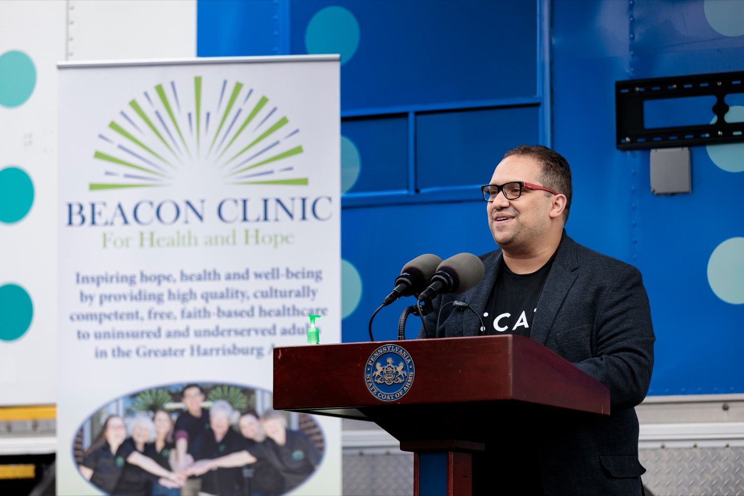 """<a href=""""https://filesource.wostreaming.net/commonwealthofpa/photo/18675_DOH_Beacon_Clinic_NK_017.jpg"""" target=""""_blank"""">⇣Download Photo<br></a>Latino Connection Founder & CEO George Fernandez speaks during a press conference, which discussed an upcoming COVID-19 mobile response vaccination tour to provide vaccinations and education to minority and underserved communities across the commonwealth, outside of Beacon Clinic in Harrisburg on Monday, April 12, 2021."""
