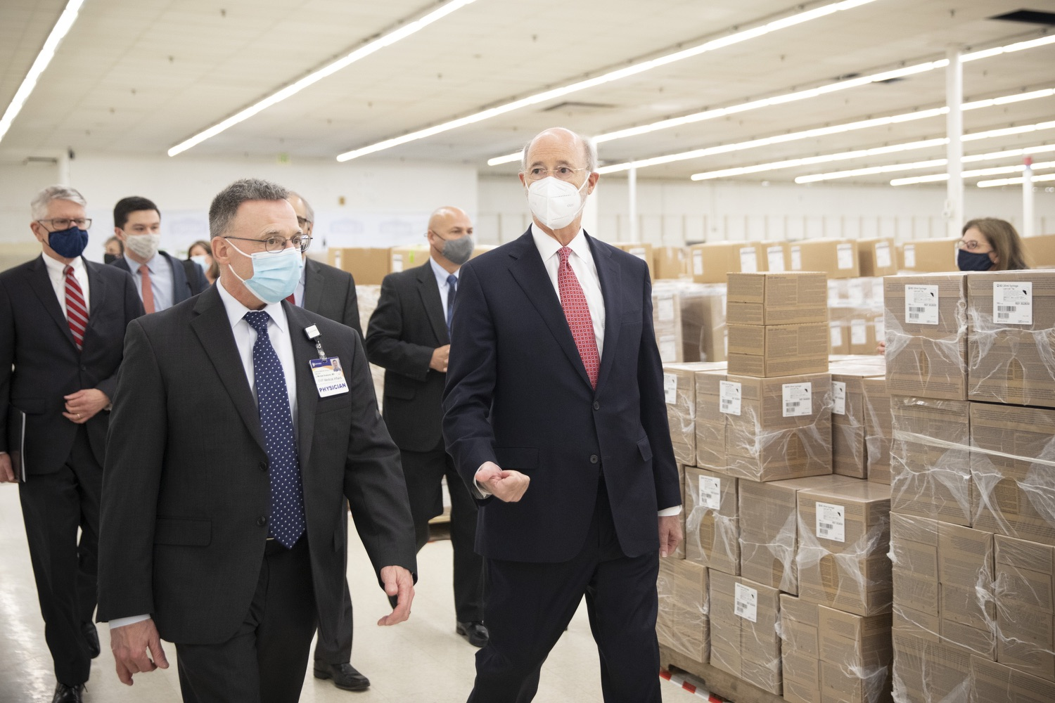 """<a href=""""https://filesource.wostreaming.net/commonwealthofpa/photo/18682_gov_vaccineClinic_dz_020.jpg"""" target=""""_blank"""">⇣Download Photo<br></a>Pennsylvania Governor Tom Wolf touring the regional vaccination clinic with Dr. J. Michael Scalzone, MD.  Governor Tom Wolf today visited the Guthrie Health vaccine clinic in Sayre, Bradford County today to tour this clinic providing vaccines to a large swath of rural residents and to talk about progress in vaccinating Pennsylvanians now that eligibility is open to all individuals age 16 and older.  Sayre, PA   April 21, 2021"""