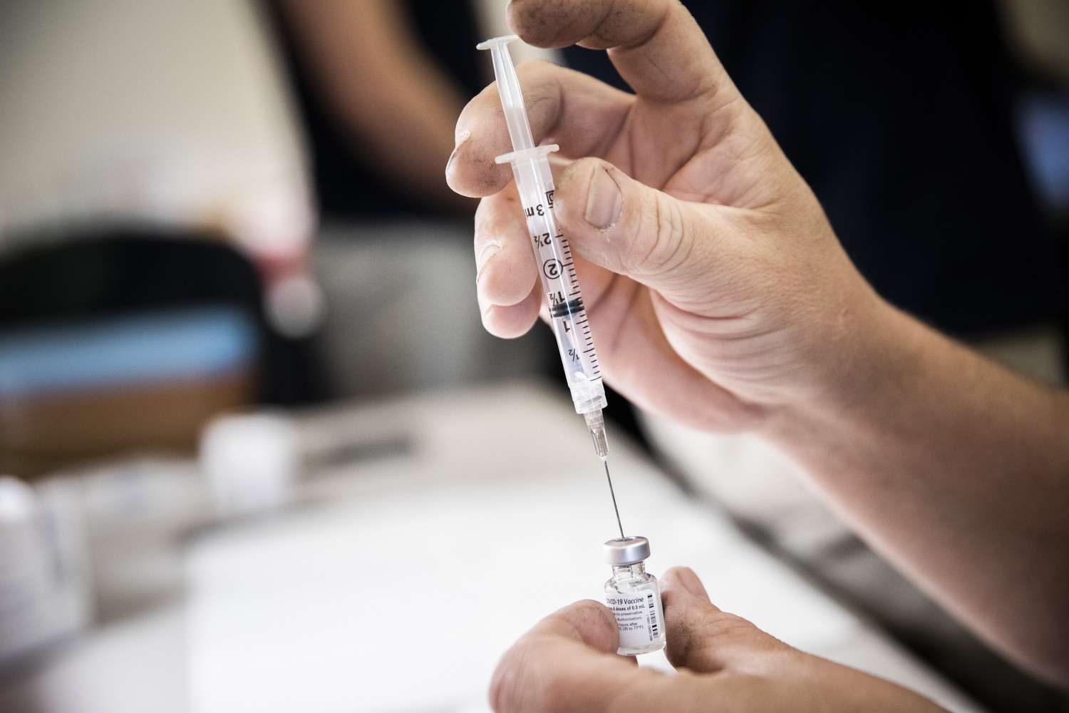 """<a href=""""https://filesource.wostreaming.net/commonwealthofpa/photo/18716_gov_erieVaccination_dz_004.jpg"""" target=""""_blank"""">⇣Download Photo<br></a>vaccine clinic workers fill syringes with COVID-19 vaccine.  Governor Tom Wolf toured a COVID-19 vaccine clinic at the Bayfront Convention Center in Erie that is operated by the Erie County Department of Health and the Lake Erie College of Osteopathic Medicine (LECOM) Institute for Successful Aging. The governor discussed the states vaccination effort and reminded all Pennsylvanians the vaccine is available, free and safe.  Erie, PA  April 28, 2021"""