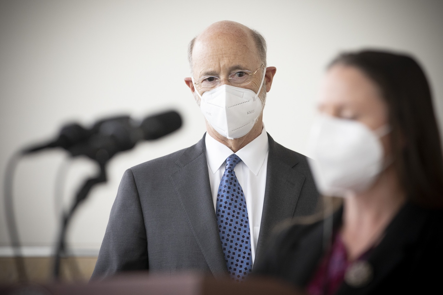 """<a href=""""https://filesource.wostreaming.net/commonwealthofpa/photo/18716_gov_erieVaccination_dz_017.jpg"""" target=""""_blank"""">⇣Download Photo<br></a>Pennsylvania Governor Tom Wolf listens as Melissa Lyon, Director, Erie County Department of Health speaks with the press.  Governor Tom Wolf toured a COVID-19 vaccine clinic at the Bayfront Convention Center in Erie that is operated by the Erie County Department of Health and the Lake Erie College of Osteopathic Medicine (LECOM) Institute for Successful Aging. The governor discussed the states vaccination effort and reminded all Pennsylvanians the vaccine is available, free and safe.  Erie, PA  April 28, 2021"""