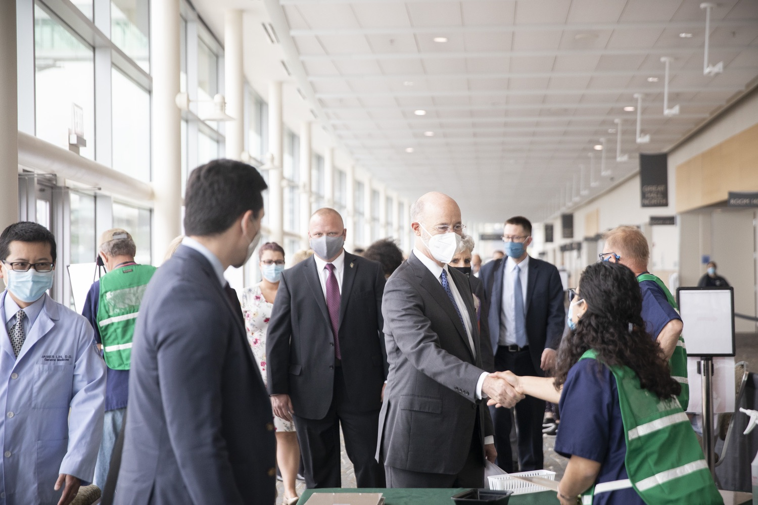 """<a href=""""https://filesource.wostreaming.net/commonwealthofpa/photo/18716_gov_erieVaccination_dz_019.jpg"""" target=""""_blank"""">⇣Download Photo<br></a>Pennsylvania Governor Tom Wolf touring the COVID-19 vaccine clinic and greeting workers. Governor Tom Wolf toured a COVID-19 vaccine clinic at the Bayfront Convention Center in Erie that is operated by the Erie County Department of Health and the Lake Erie College of Osteopathic Medicine (LECOM) Institute for Successful Aging. The governor discussed the states vaccination effort and reminded all Pennsylvanians the vaccine is available, free and safe.  Erie, PA  April 28, 2021"""