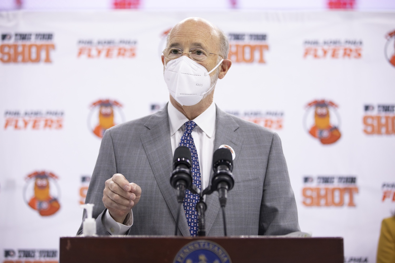"<a href=""https://filesource.wostreaming.net/commonwealthofpa/photo/18727_gov_vaccines_dz_002.JPG"" target=""_blank"">⇣ Download Photo<br></a>Pennsylvania Governor Tom Wolf speaking with the press.   Governor Tom Wolf today visited the Philadelphia Flyers organization at the Wells Fargo Center in Philadelphia to discuss COVID-19 vaccine efforts in Pennsylvania. The Flyers recently launched a comprehensive COVID-19 vaccine campaign, Take Your Shot, encouraging Pennsylvanians to get vaccinated.  Philadelphia, PA  MAY 3, 2021"