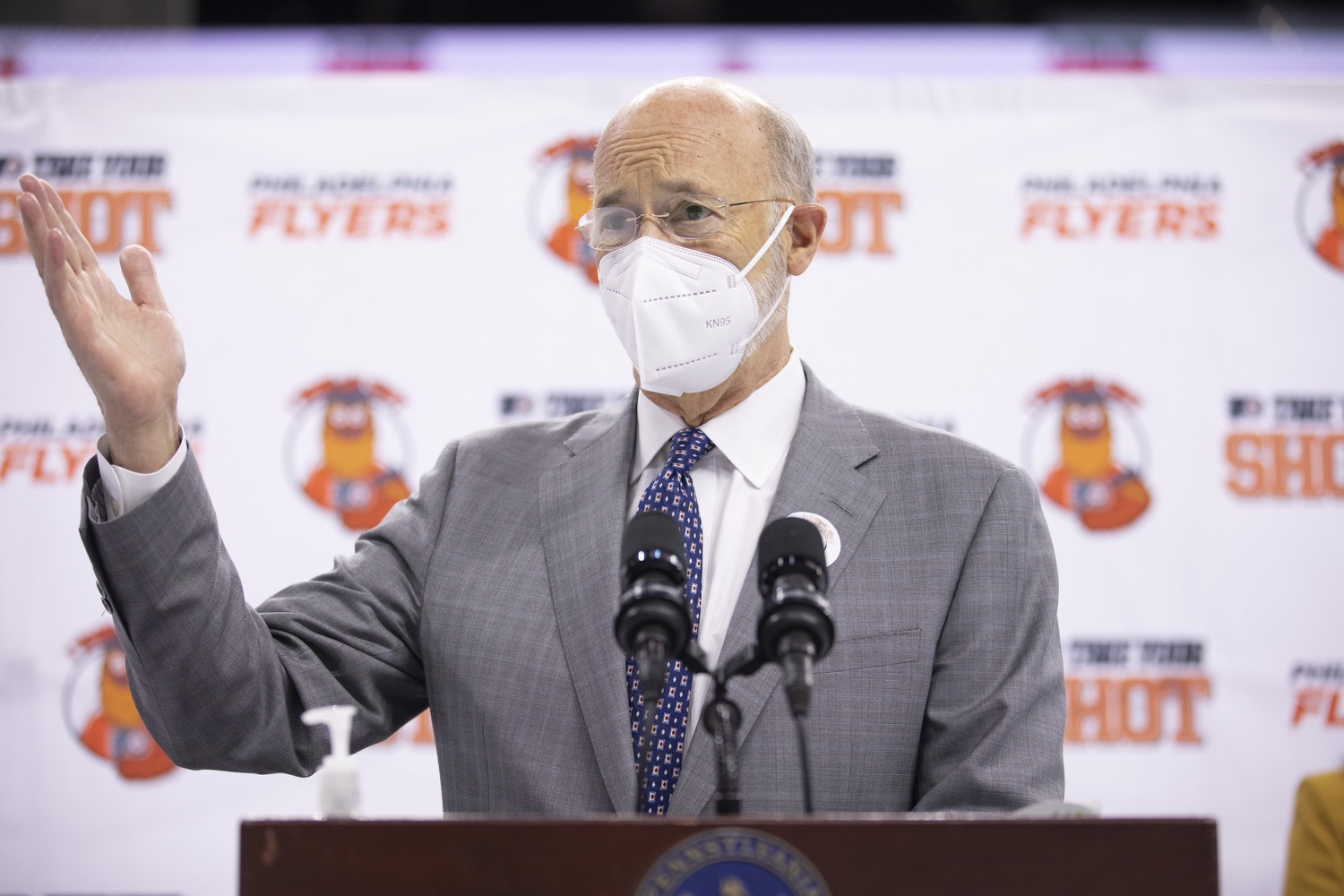 """<a href=""""https://filesource.wostreaming.net/commonwealthofpa/photo/18727_gov_vaccines_dz_005.JPG"""" target=""""_blank"""">⇣Download Photo<br></a>Pennsylvania Governor Tom Wolf speaking with the press.   Governor Tom Wolf today visited the Philadelphia Flyers organization at the Wells Fargo Center in Philadelphia to discuss COVID-19 vaccine efforts in Pennsylvania. The Flyers recently launched a comprehensive COVID-19 vaccine campaign, Take Your Shot, encouraging Pennsylvanians to get vaccinated.  Philadelphia, PA  MAY 3, 2021"""