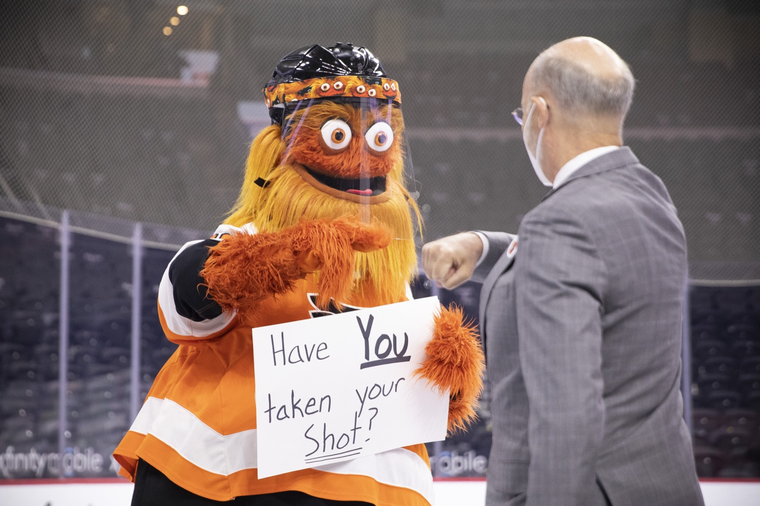 """<a href=""""https://filesource.wostreaming.net/commonwealthofpa/photo/18727_gov_vaccines_dz_006.jpg"""" target=""""_blank"""">⇣Download Photo<br></a>Philadelphia Flyers' mascot Gritty greeting Governor Tom Wolf.   Governor Tom Wolf today visited the Philadelphia Flyers organization at the Wells Fargo Center in Philadelphia to discuss COVID-19 vaccine efforts in Pennsylvania. The Flyers recently launched a comprehensive COVID-19 vaccine campaign, Take Your Shot, encouraging Pennsylvanians to get vaccinated.  Philadelphia, PA  MAY 3, 2021"""