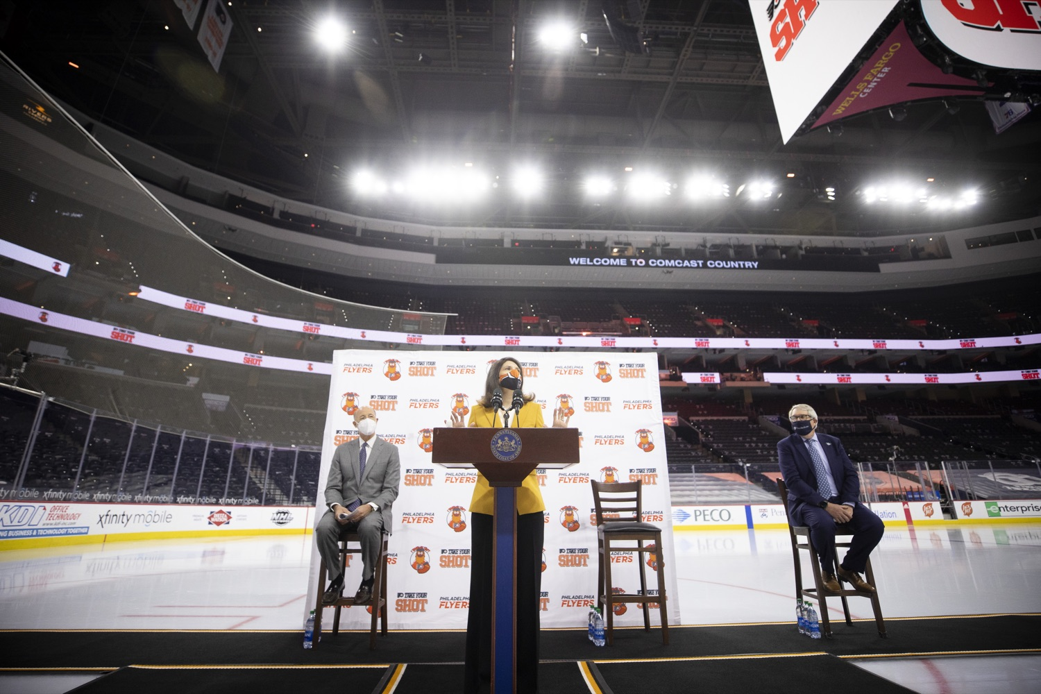 """<a href=""""https://filesource.wostreaming.net/commonwealthofpa/photo/18727_gov_vaccines_dz_010.jpg"""" target=""""_blank"""">⇣Download Photo<br></a>Valerie Camillo, President of Business Operations, Philadelphia Flyers & Wells Fargo speaking with the press.   Governor Tom Wolf today visited the Philadelphia Flyers organization at the Wells Fargo Center in Philadelphia to discuss COVID-19 vaccine efforts in Pennsylvania. The Flyers recently launched a comprehensive COVID-19 vaccine campaign, Take Your Shot, encouraging Pennsylvanians to get vaccinated.  Philadelphia, PA  MAY 3, 2021"""