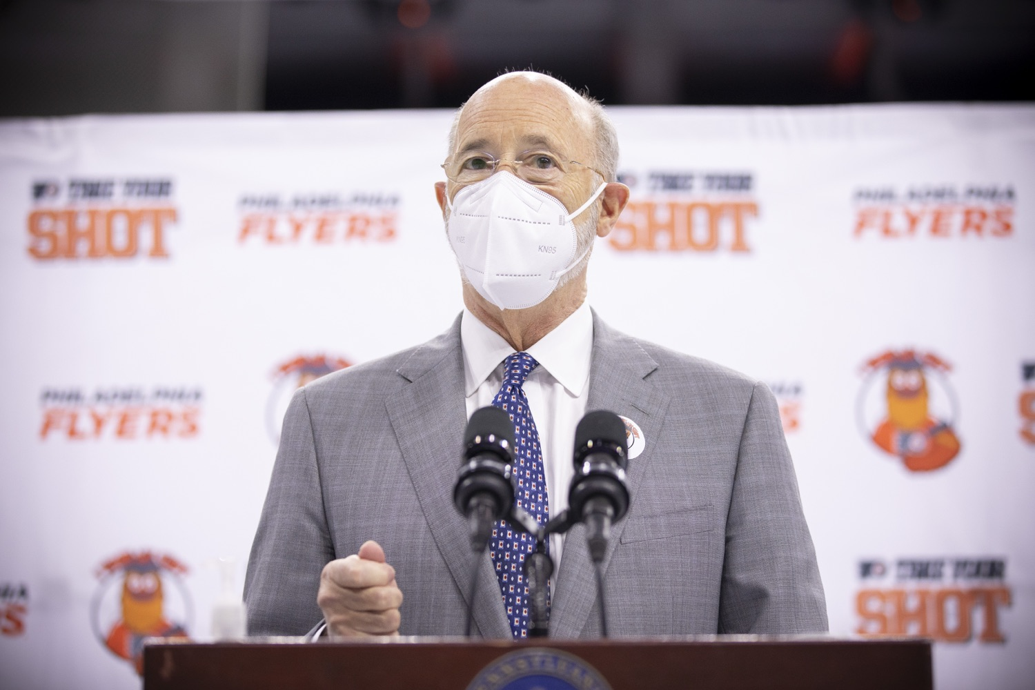"<a href=""https://filesource.wostreaming.net/commonwealthofpa/photo/18727_gov_vaccines_dz_014.jpg"" target=""_blank"">⇣ Download Photo<br></a>Pennsylvania Governor Tom Wolf speaking with the press.   Governor Tom Wolf today visited the Philadelphia Flyers organization at the Wells Fargo Center in Philadelphia to discuss COVID-19 vaccine efforts in Pennsylvania. The Flyers recently launched a comprehensive COVID-19 vaccine campaign, Take Your Shot, encouraging Pennsylvanians to get vaccinated.  Philadelphia, PA  MAY 3, 2021"