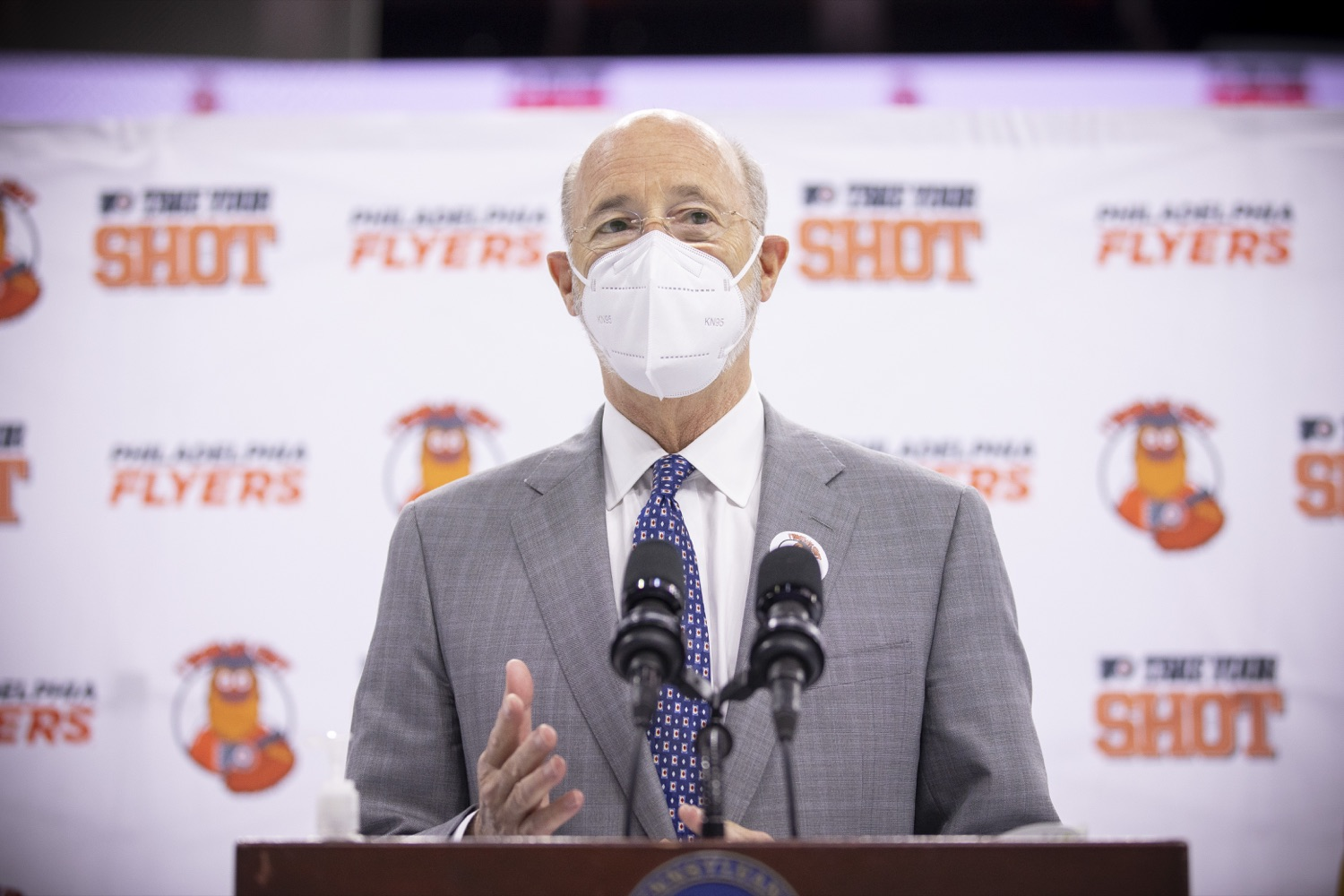"""<a href=""""https://filesource.wostreaming.net/commonwealthofpa/photo/18727_gov_vaccines_dz_017.jpg"""" target=""""_blank"""">⇣Download Photo<br></a>Pennsylvania Governor Tom Wolf speaking with the press.   Governor Tom Wolf today visited the Philadelphia Flyers organization at the Wells Fargo Center in Philadelphia to discuss COVID-19 vaccine efforts in Pennsylvania. The Flyers recently launched a comprehensive COVID-19 vaccine campaign, Take Your Shot, encouraging Pennsylvanians to get vaccinated.  Philadelphia, PA  MAY 3, 2021"""