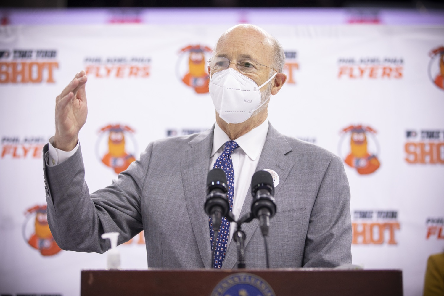"""<a href=""""https://filesource.wostreaming.net/commonwealthofpa/photo/18727_gov_vaccines_dz_023.jpg"""" target=""""_blank"""">⇣Download Photo<br></a>Pennsylvania Governor Tom Wolf speaking with the press.   Governor Tom Wolf today visited the Philadelphia Flyers organization at the Wells Fargo Center in Philadelphia to discuss COVID-19 vaccine efforts in Pennsylvania. The Flyers recently launched a comprehensive COVID-19 vaccine campaign, Take Your Shot, encouraging Pennsylvanians to get vaccinated.  Philadelphia, PA  MAY 3, 2021"""