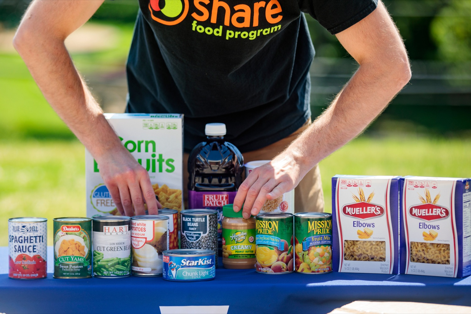 """<a href=""""https://filesource.wostreaming.net/commonwealthofpa/photo/18761_AGRIC_Senior_Food_Box_NK_007.jpg"""" target=""""_blank"""">⇣Download Photo<br></a>John Sudolsky, senior food box program manager for the Share Food Program, arranges food during a press conference, announcing steps to increase access to Pennsylvanias Senior Food Boxes, a supplemental food program available free to lower income seniors, outside Kings Terrace in Phoenixville on Wednesday, May 19, 2021."""