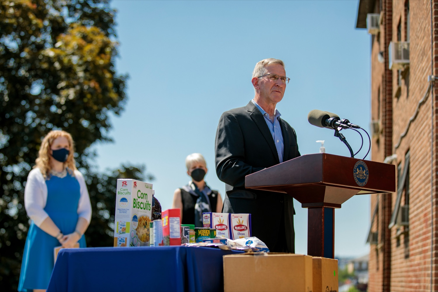 """<a href=""""https://filesource.wostreaming.net/commonwealthofpa/photo/18761_AGRIC_Senior_Food_Box_NK_015.jpg"""" target=""""_blank"""">⇣Download Photo<br></a>PA Dept. of Agriculture Secretary Russell Redding speaks during a press conference, announcing steps to increase access to Pennsylvanias Senior Food Boxes, a supplemental food program available free to lower income seniors, outside Kings Terrace in Phoenixville on Wednesday, May 19, 2021."""