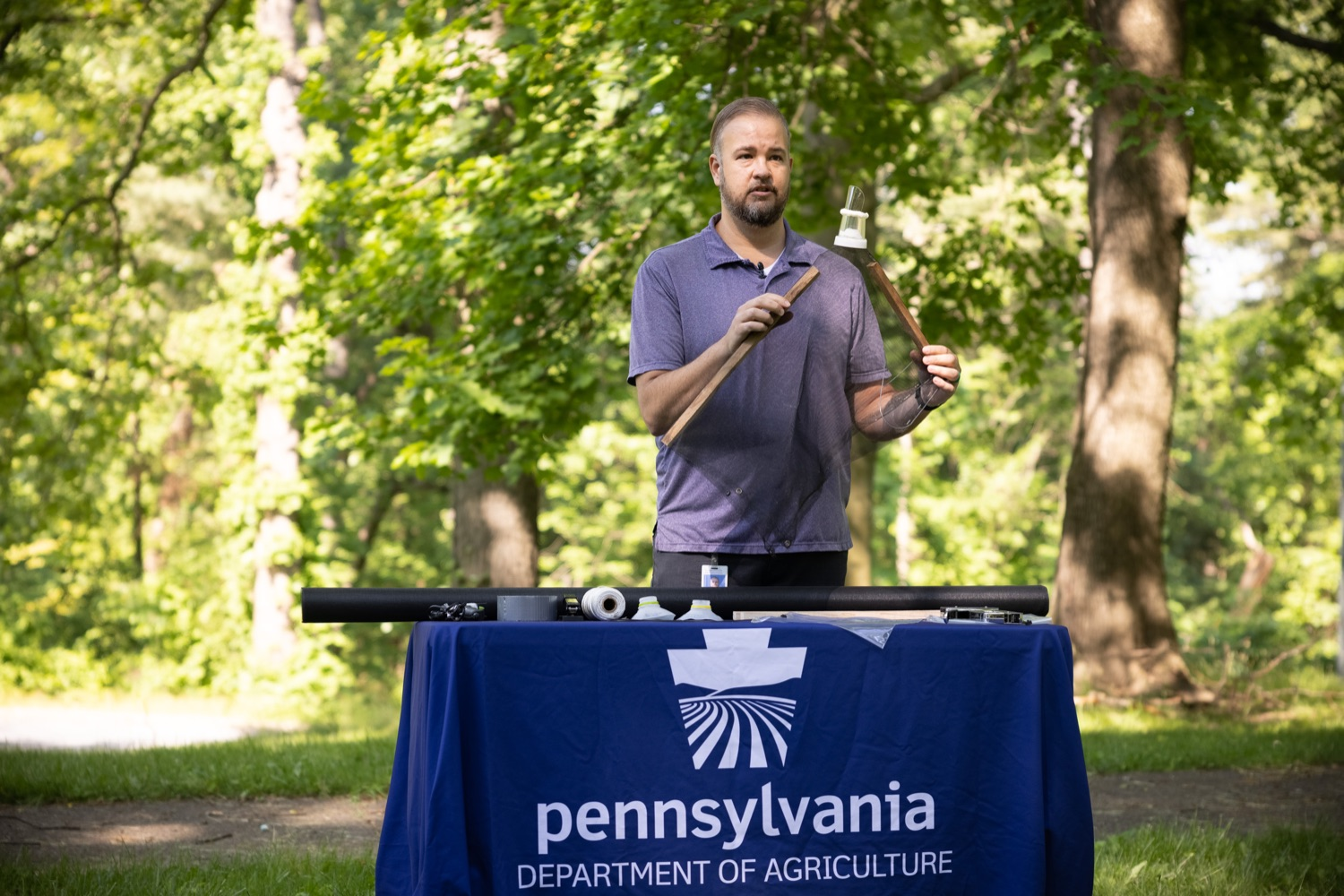 """<a href=""""https://filesource.wostreaming.net/commonwealthofpa/photo/18762_agric_slftrap_dz_017.jpg"""" target=""""_blank"""">⇣Download Photo<br></a>Jay Losiewicz, a specialist with the PA Department of Agriculture speaking with the press. Today in Harrisburg, a specialist from the PA Department of Agriculture demonstrated how homeowners can use a circle trap to eliminate large numbers of destructive Spotted Lanternflies without harming beneficial pollinators or small animals.   Harrisburg, PA  May 21, 2021"""
