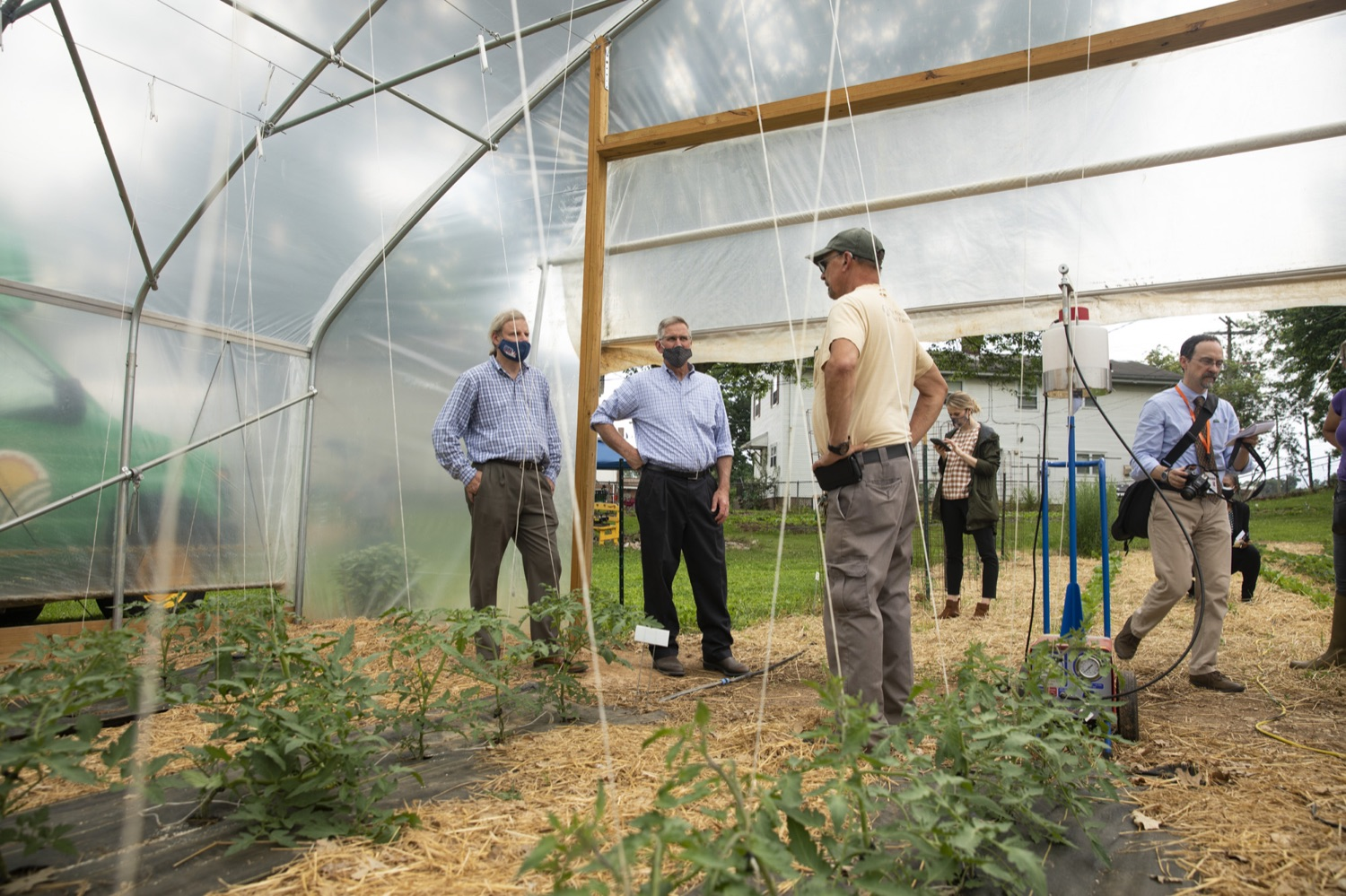 """<a href=""""https://filesource.wostreaming.net/commonwealthofpa/photo/18787_agric_urbangardens_01.jpg"""" target=""""_blank"""">⇣Download Photo<br></a>Bruce Manns gives Secretary Russell Redding a tour of the many greenhouses and gardens at York Fresh Food Farms, in York, PA on July 3, 2021."""