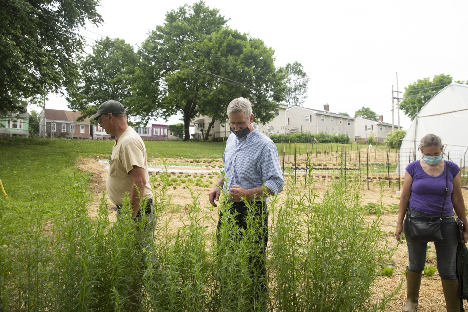 """<a href=""""https://filesource.wostreaming.net/commonwealthofpa/photo/18787_agric_urbangardens_12.jpg"""" target=""""_blank"""">⇣Download Photo<br></a>Secretary of Agriculture Russell Redding tours York Fresh Food Farms, one of many urban spaces in Pennsylvania seeking to stomp out food insecurity, June 3, 2021."""