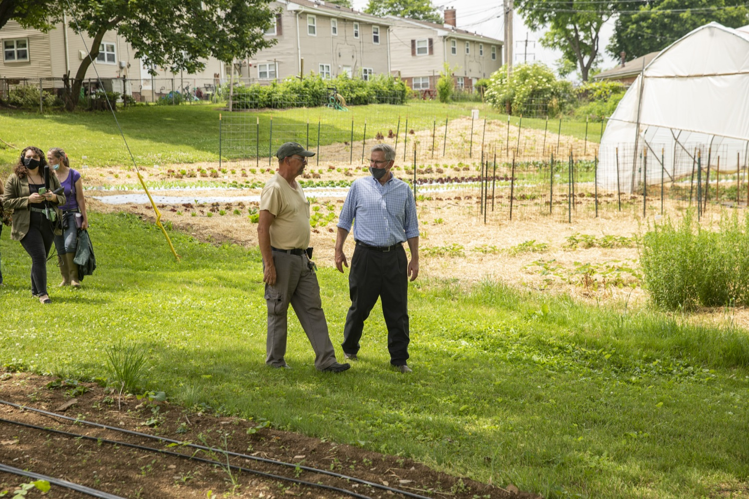 """<a href=""""https://filesource.wostreaming.net/commonwealthofpa/photo/18787_agric_urbangardens_13.jpg"""" target=""""_blank"""">⇣Download Photo<br></a>Bruce Manns gives Secretary Russell Redding a tour of the many greenhouses and gardens at York Fresh Food Farms, in York, PA on July 3, 2021."""