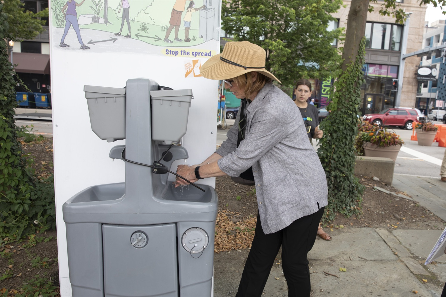 """<a href=""""https://filesource.wostreaming.net/commonwealthofpa/photo/18880_fl_outdooropportunites_cz_05.jpg"""" target=""""_blank"""">⇣Download Photo<br></a>Secretary of DCNR Cindy Dunn uses a hand-washing station, one of many public amenities at Allegheny Overlook Pop-up Park in Pittsburgh, PA on July 7, 2021."""