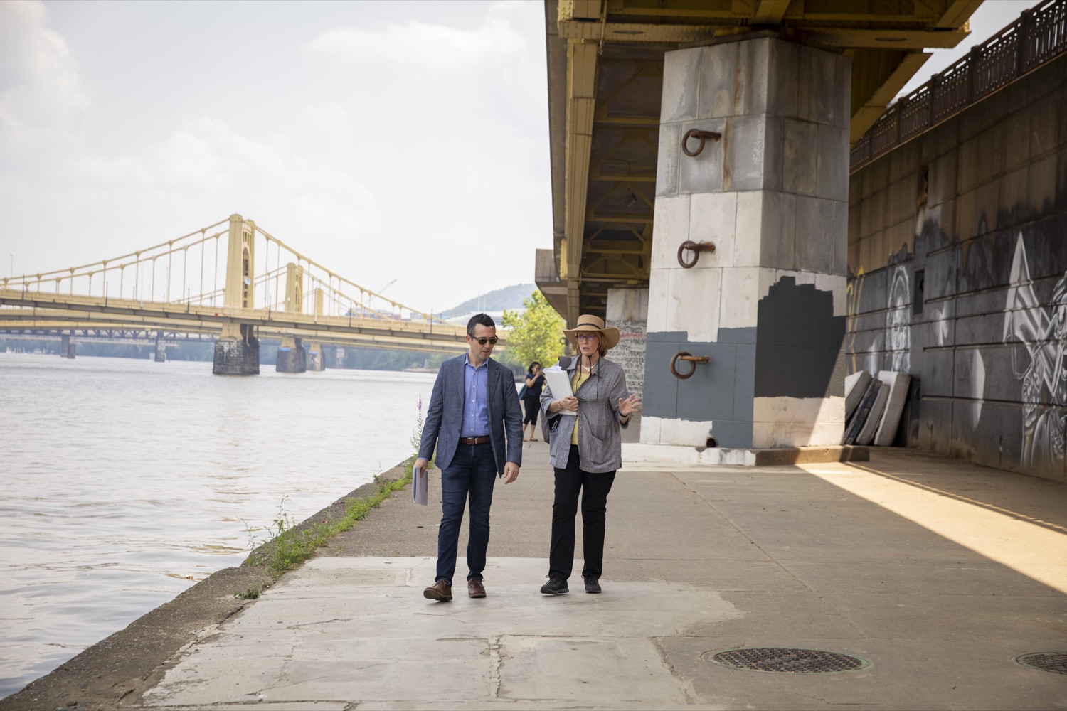 """<a href=""""https://filesource.wostreaming.net/commonwealthofpa/photo/18880_fl_outdooropportunites_cz_11.jpg"""" target=""""_blank"""">⇣Download Photo<br></a>Secretary of DCNR Cindy Dunn walks with Matthew Galluzzo, President and CEO of Riverlife, along the lower riverfront trail, in Pittsburgh, PA on July 7, 2021."""