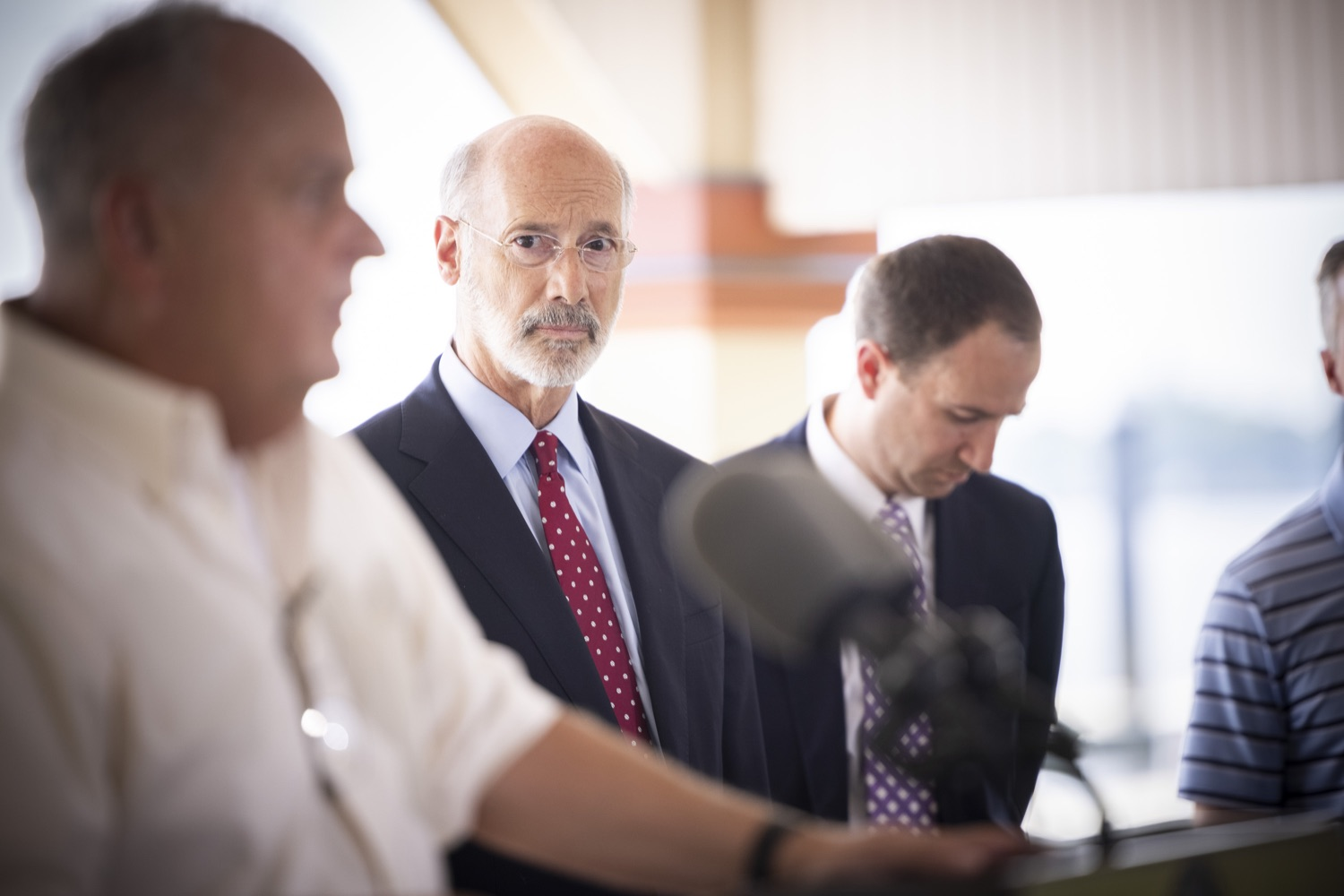 """<a href=""""https://filesource.wostreaming.net/commonwealthofpa/photo/18932_gov_chirp_dz_010.jpg"""" target=""""_blank"""">⇣Download Photo<br></a>Pennsylvania Governor Tom Wolf listens as Pennsylvania State Representative John Galloway speaks.  Governor Tom Wolf today joined the Pennsylvania Department of Community and Economic Development, Bucks County Commissioners, Bristol Borough Mayor Joseph Saxton, local lawmakers, Bucks County Economic Development Corporation, Visit Bucks County, the Bucks County Redevelopment Authority, and the owners of Itri Wood Fired to highlight the $7 million in grant funding provided to Bucks County restaurants through the COVID-19 Hospitality Industry Recovery Program(CHIRP).  JULY 16, 2021 - BRISTOL, PA"""