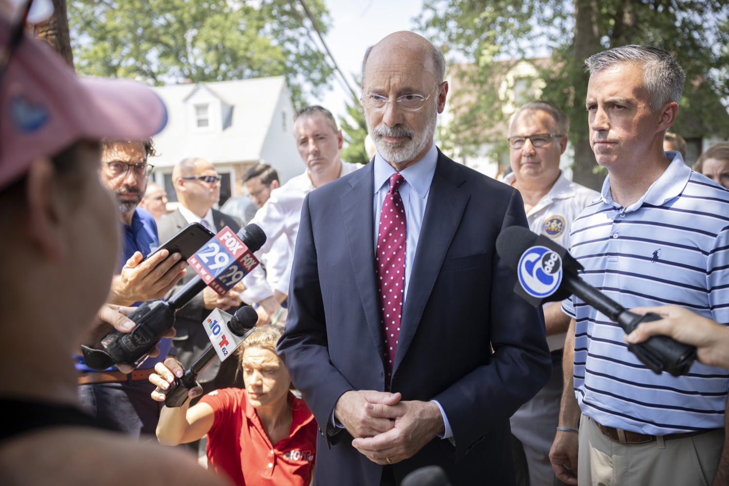 """<a href=""""https://filesource.wostreaming.net/commonwealthofpa/photo/18934_gov_stormdamage_dz_001.jpg"""" target=""""_blank"""">⇣Download Photo<br></a>Pennsylvania Governor Tom Wolf speaking with flood victims and public officials.    Governor Tom Wolf visited Bristol and Andalusia in Bucks County to tour communities affected by severe weather and flash flooding. The governor was joined by local officials and legislators to visit damaged homes and speak to residents. JULY 16, 2021 - ANDALUSIA, PA"""