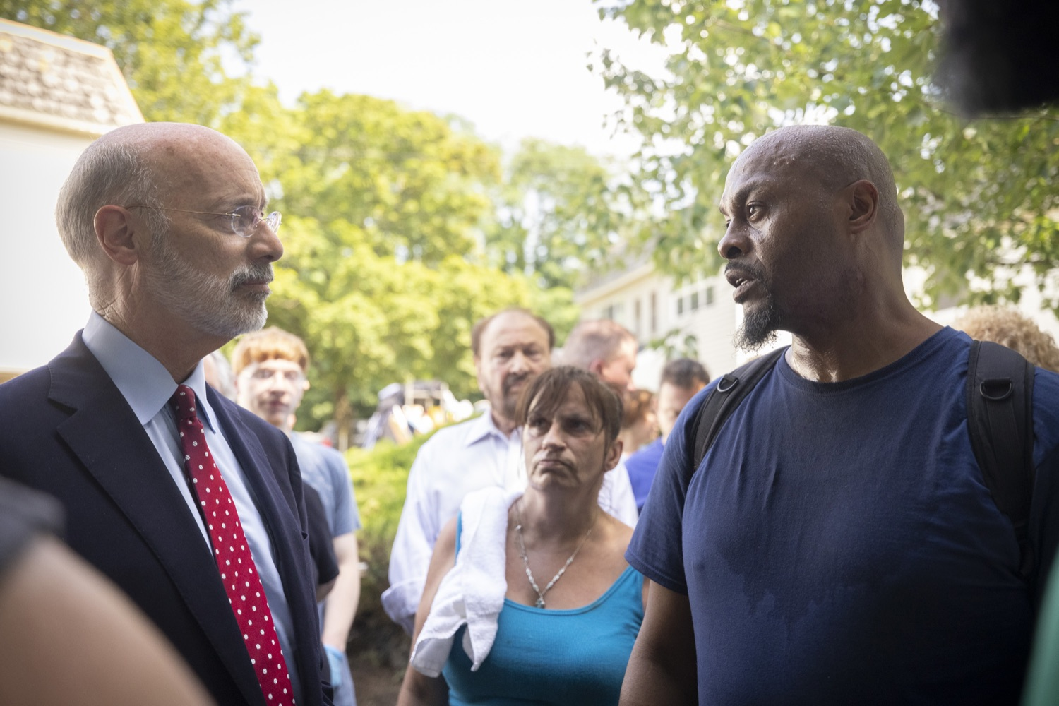 """<a href=""""https://filesource.wostreaming.net/commonwealthofpa/photo/18934_gov_stormdamage_dz_002.jpg"""" target=""""_blank"""">⇣Download Photo<br></a>Jermaine Hoskins a victim of the flooding speaking with Pennsylvania Governor Tom Wolf.  Governor Tom Wolf visited Bristol and Andalusia in Bucks County to tour communities affected by severe weather and flash flooding. The governor was joined by local officials and legislators to visit damaged homes and speak to residents. JULY 16, 2021 - ANDALUSIA, PA"""