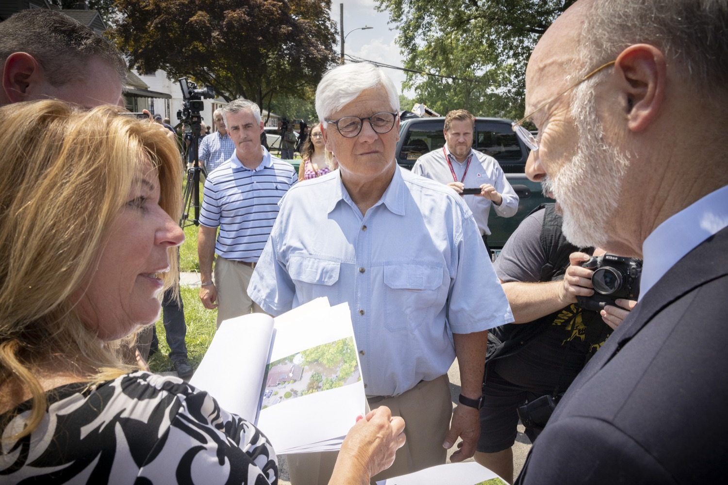 """<a href=""""https://filesource.wostreaming.net/commonwealthofpa/photo/18934_gov_stormdamage_dz_004.jpg"""" target=""""_blank"""">⇣Download Photo<br></a>Pennsylvania Governor Tom Wolf speaking with flood victims and public officials.    Governor Tom Wolf visited Bristol and Andalusia in Bucks County to tour communities affected by severe weather and flash flooding. The governor was joined by local officials and legislators to visit damaged homes and speak to residents. JULY 16, 2021 - ANDALUSIA, PA"""