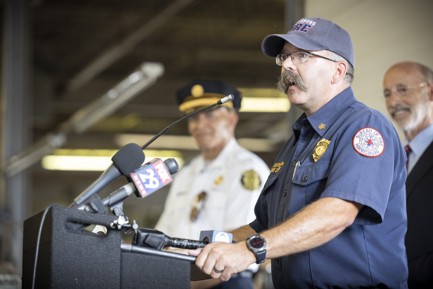 """<a href=""""https://filesource.wostreaming.net/commonwealthofpa/photo/18936_gov_taskforceone_dz_003.jpg"""" target=""""_blank"""">⇣Download Photo<br></a>Pennsylvania-Task Force 1 member Chief Brian Enterline thanking members of Pennsylvania-Task Force.  Governor Tom Wolf thanked members of Pennsylvania-Task Force 1 (PA- TF1), who returned today to Philadelphia after spending two weeks assisting with search and rescue efforts at the site of the recent deadly building collapse in Surfside, Florida.  Philadelphia, Pa.  July 16, 2021"""