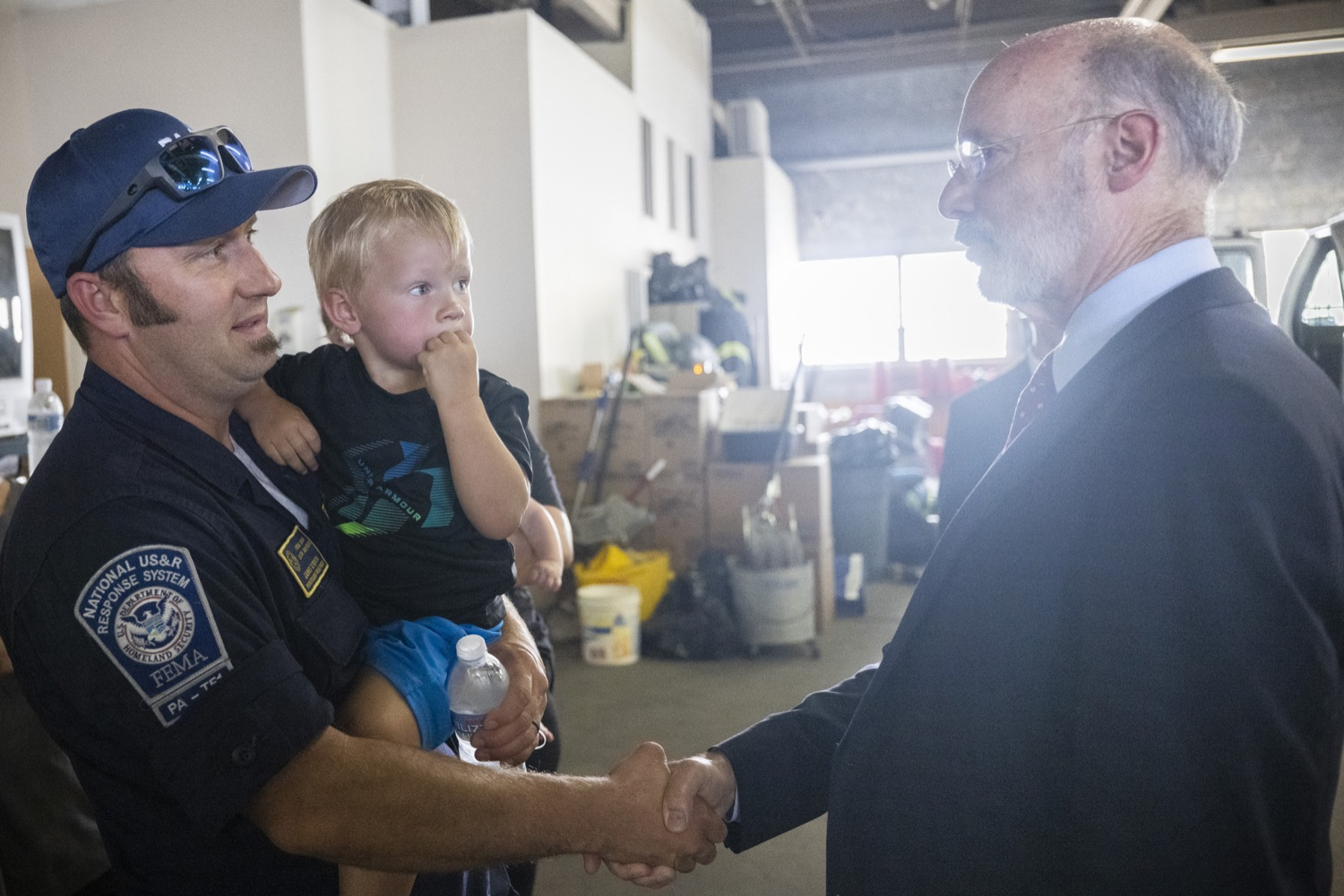 """<a href=""""https://filesource.wostreaming.net/commonwealthofpa/photo/18936_gov_taskforceone_dz_004.jpg"""" target=""""_blank"""">⇣Download Photo<br></a>Governor Tom Wolf speaking to returning Pennsylvania-Task Force 1. Members.Governor Tom Wolf thanked members of Pennsylvania-Task Force 1 (PA- TF1), who returned today to Philadelphia after spending two weeks assisting with search and rescue efforts at the site of the recent deadly building collapse in Surfside, Florida.  Philadelphia, Pa.  July 16, 2021"""