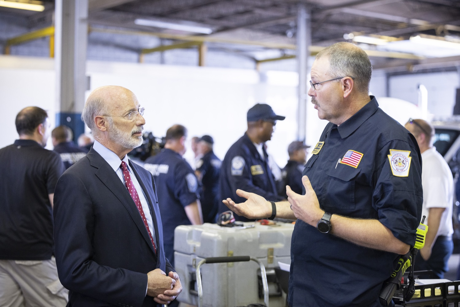 """<a href=""""https://filesource.wostreaming.net/commonwealthofpa/photo/18936_gov_taskforceone_dz_006.jpg"""" target=""""_blank"""">⇣Download Photo<br></a>Governor Tom Wolf speaking to PEMA Director Randy Padfield.  Governor Tom Wolf thanked members of Pennsylvania-Task Force 1 (PA- TF1), who returned today to Philadelphia after spending two weeks assisting with search and rescue efforts at the site of the recent deadly building collapse in Surfside, Florida.  Philadelphia, Pa.  July 16, 2021"""