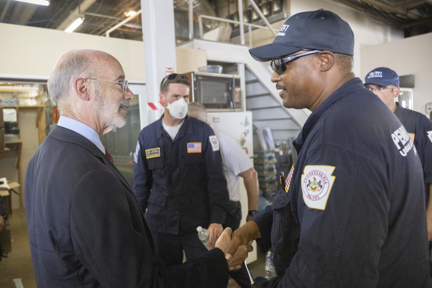 """<a href=""""https://filesource.wostreaming.net/commonwealthofpa/photo/18936_gov_taskforceone_dz_015.jpg"""" target=""""_blank"""">⇣Download Photo<br></a>Governor Tom Wolf speaking to returning Pennsylvania-Task Force 1. Members.Governor Tom Wolf thanked members of Pennsylvania-Task Force 1 (PA- TF1), who returned today to Philadelphia after spending two weeks assisting with search and rescue efforts at the site of the recent deadly building collapse in Surfside, Florida.  Philadelphia, Pa.  July 16, 2021"""