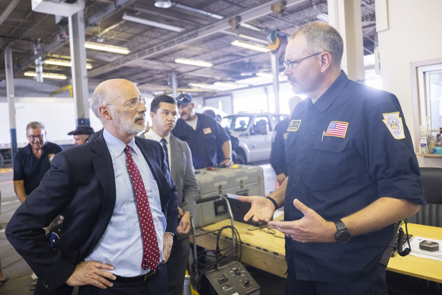"""<a href=""""https://filesource.wostreaming.net/commonwealthofpa/photo/18936_gov_taskforceone_dz_016.jpg"""" target=""""_blank"""">⇣Download Photo<br></a>Governor Tom Wolf speaking to PEMA Director Randy Padfield.  Governor Tom Wolf thanked members of Pennsylvania-Task Force 1 (PA- TF1), who returned today to Philadelphia after spending two weeks assisting with search and rescue efforts at the site of the recent deadly building collapse in Surfside, Florida.  Philadelphia, Pa.  July 16, 2021"""