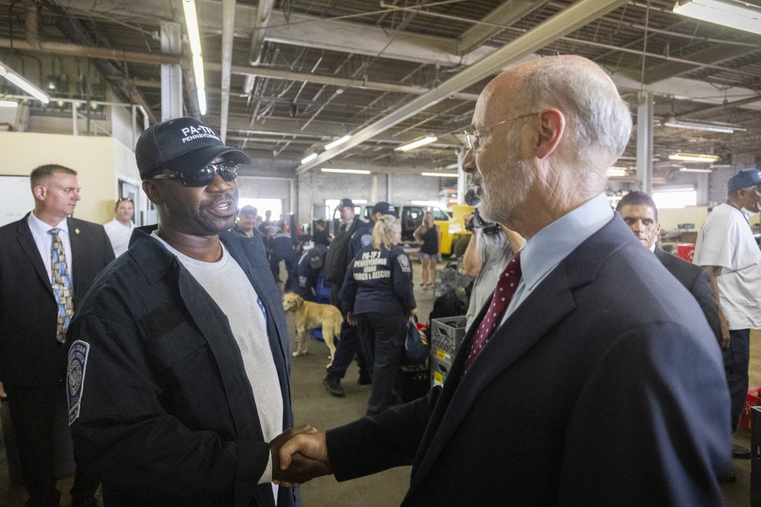 """<a href=""""https://filesource.wostreaming.net/commonwealthofpa/photo/18936_gov_taskforceone_dz_018.jpg"""" target=""""_blank"""">⇣Download Photo<br></a>Governor Tom Wolf speaking to returning Pennsylvania-Task Force 1. Members.Governor Tom Wolf thanked members of Pennsylvania-Task Force 1 (PA- TF1), who returned today to Philadelphia after spending two weeks assisting with search and rescue efforts at the site of the recent deadly building collapse in Surfside, Florida.  Philadelphia, Pa.  July 16, 2021"""