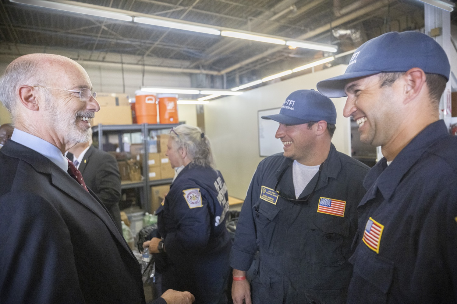 """<a href=""""https://filesource.wostreaming.net/commonwealthofpa/photo/18936_gov_taskforceone_dz_019.jpg"""" target=""""_blank"""">⇣Download Photo<br></a>Governor Tom Wolf speaking to returning Pennsylvania-Task Force 1. Members.Governor Tom Wolf thanked members of Pennsylvania-Task Force 1 (PA- TF1), who returned today to Philadelphia after spending two weeks assisting with search and rescue efforts at the site of the recent deadly building collapse in Surfside, Florida.  Philadelphia, Pa.  July 16, 2021"""
